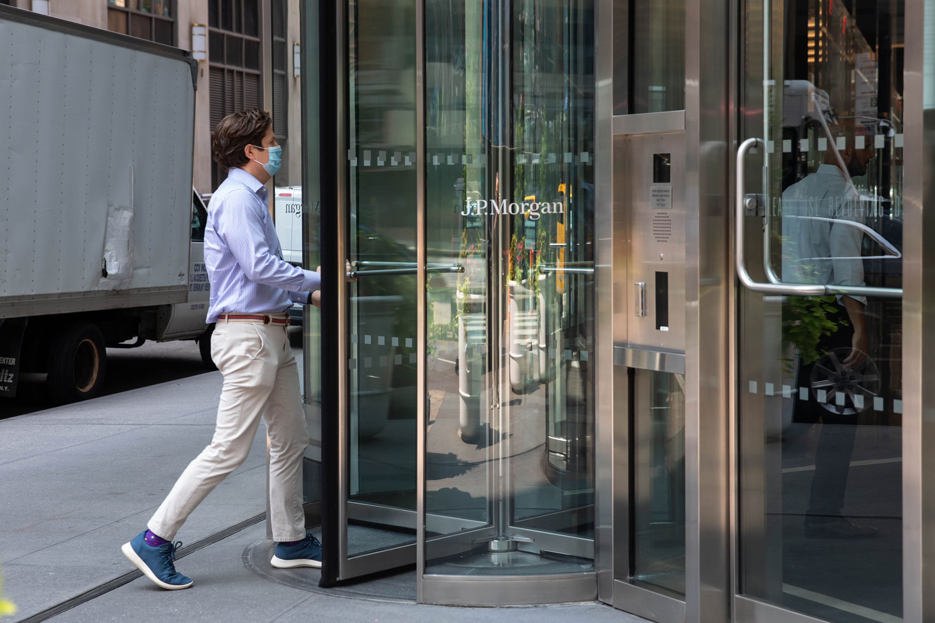 An office worker enters the JPMorgan Chase & Co. headquarters in New York on July 22.