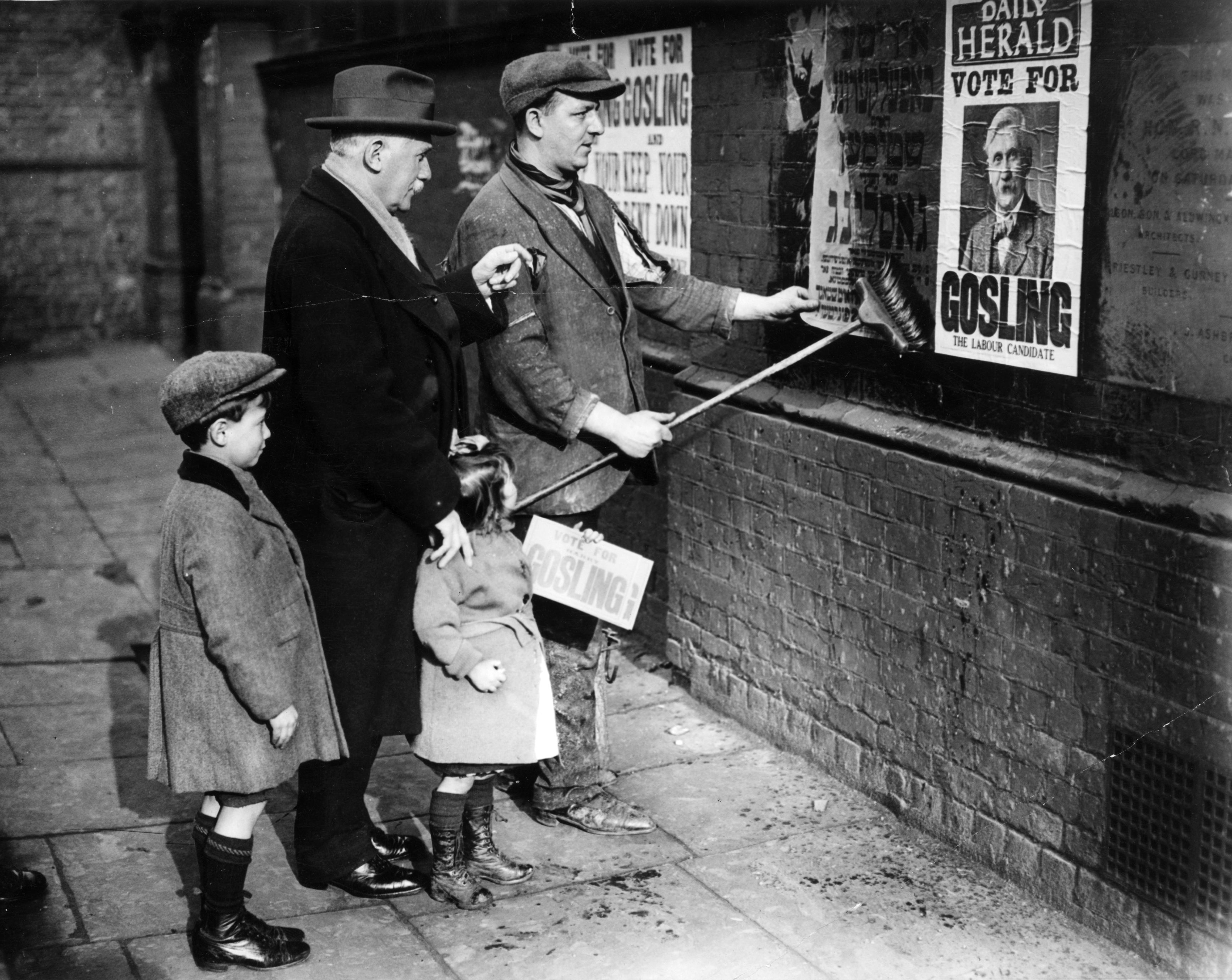 Labour Party candidate Henry Gosling supervises a poster campaign during the election.