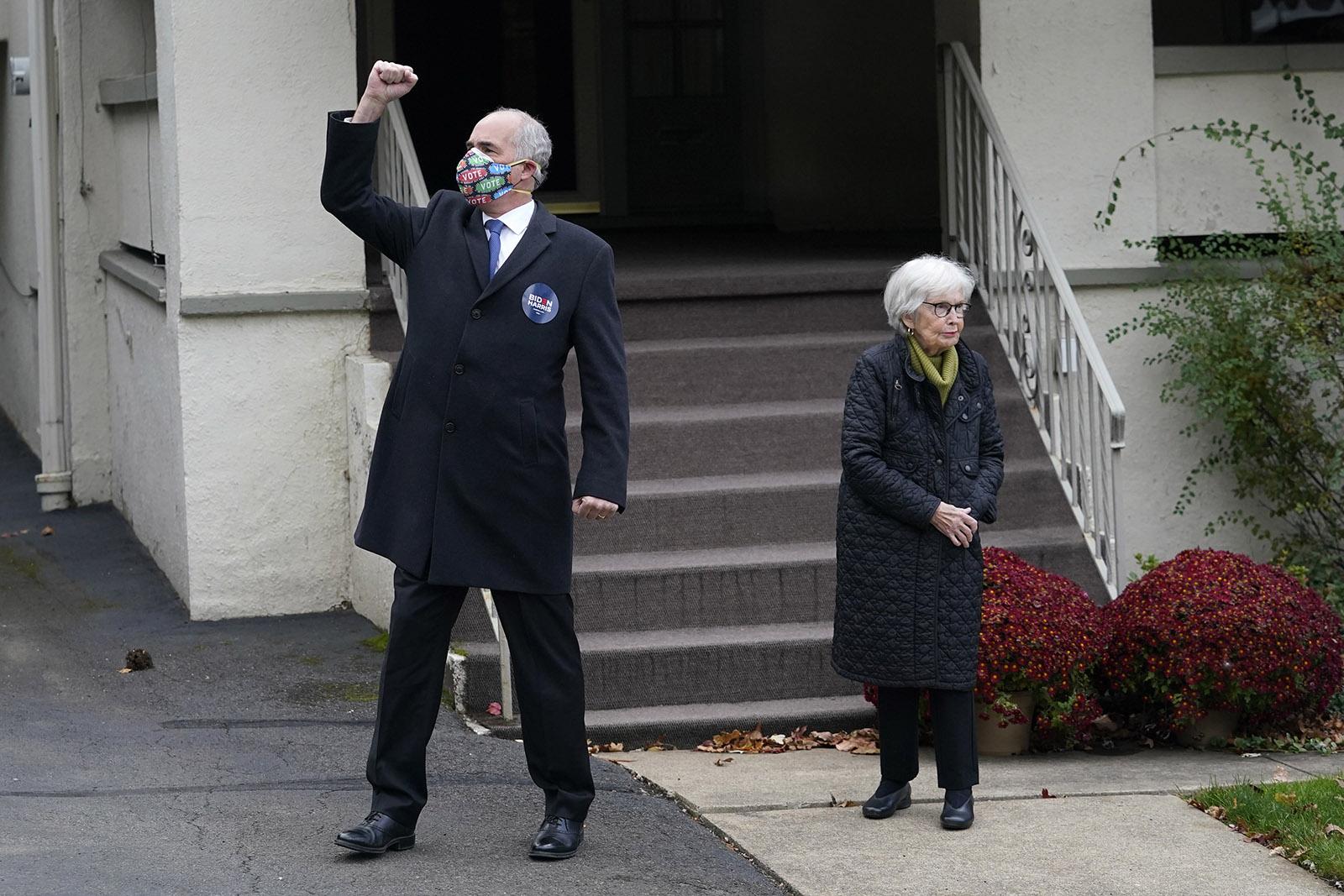 Sen. Bob Casey gestures while standing with his mother, Ellen Harding Casey, in Scranton, Pennsylvania, on Tuesday, November 3.