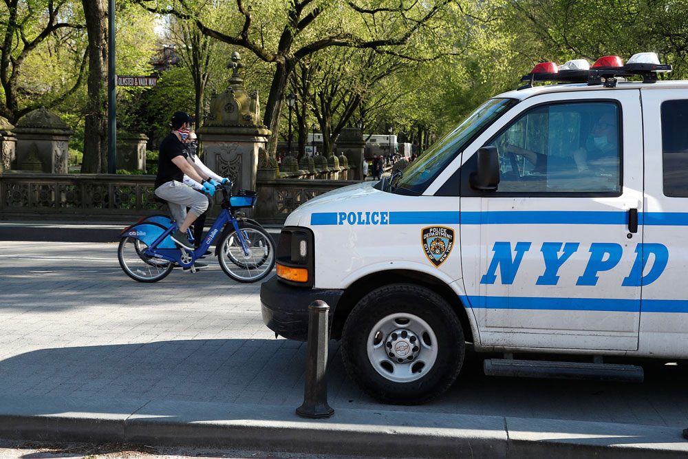 NYPD patrols Central park to assure people keep to social distancing rules during the coronavirus pandemic on May 2 in New York City.
