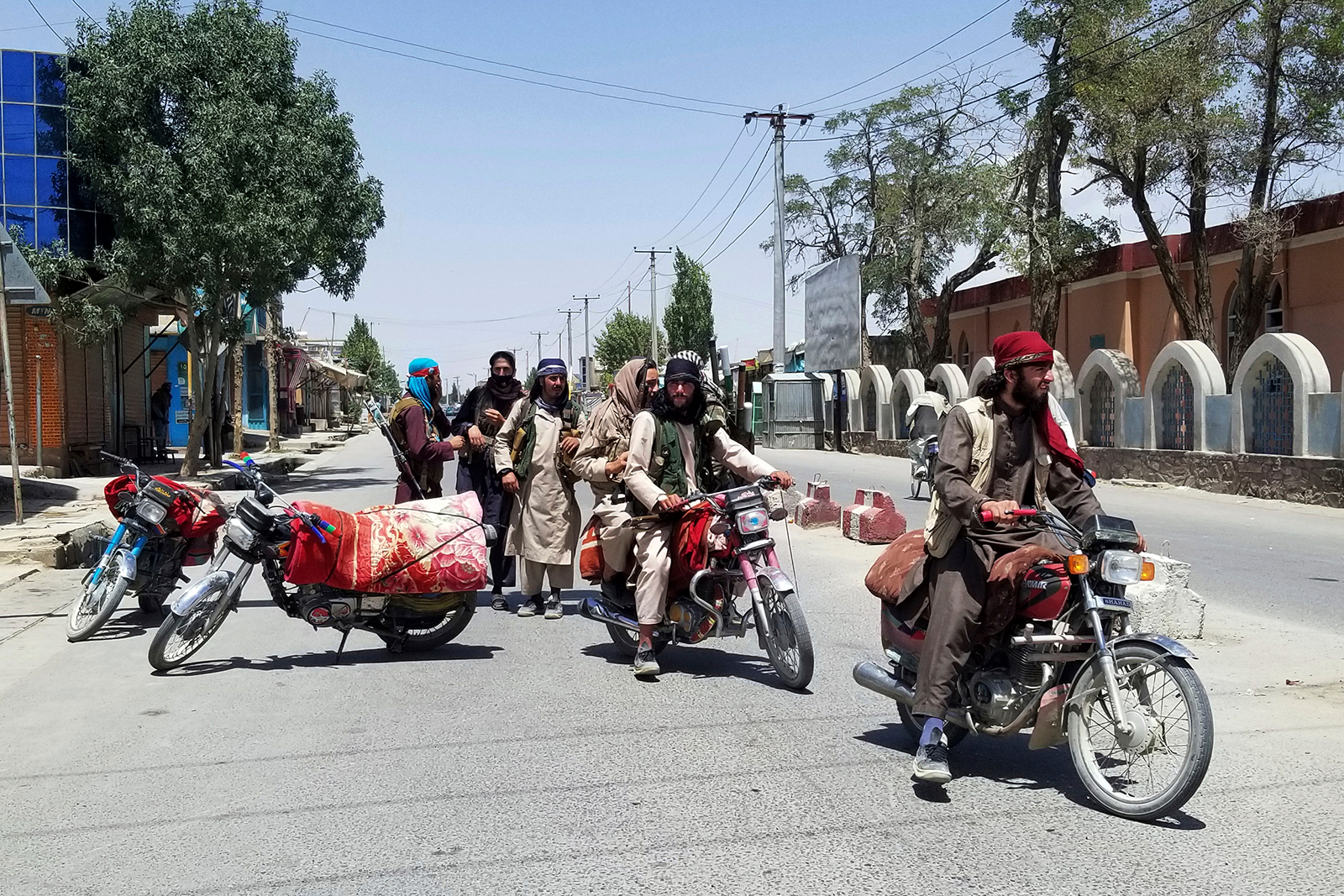 Taliban fighters patrol inside the city of Ghazni, southwest of Kabul, on Thursday.