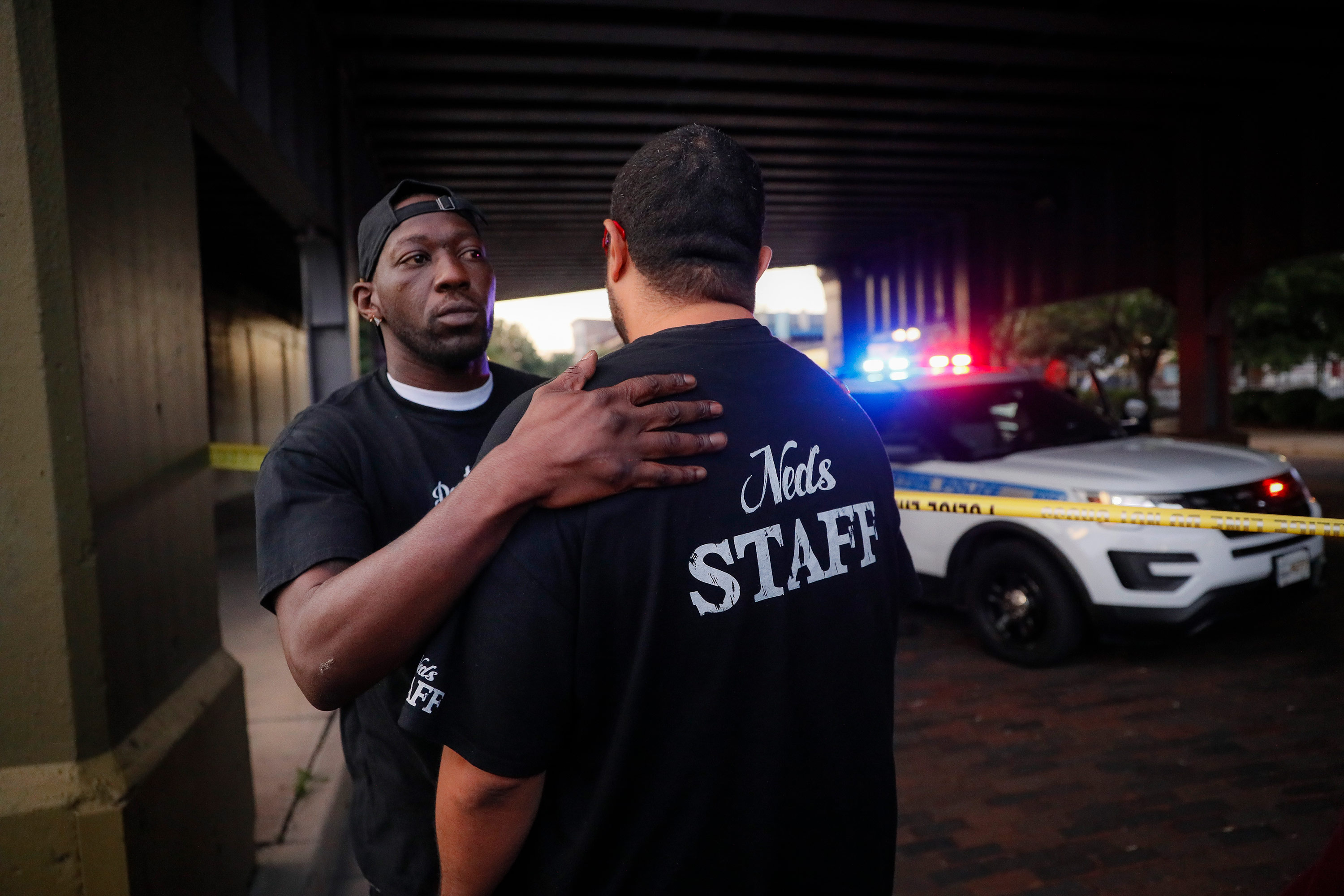 Witnesses comfort one another at the scene of the mass shooting in Dayton, Ohio.