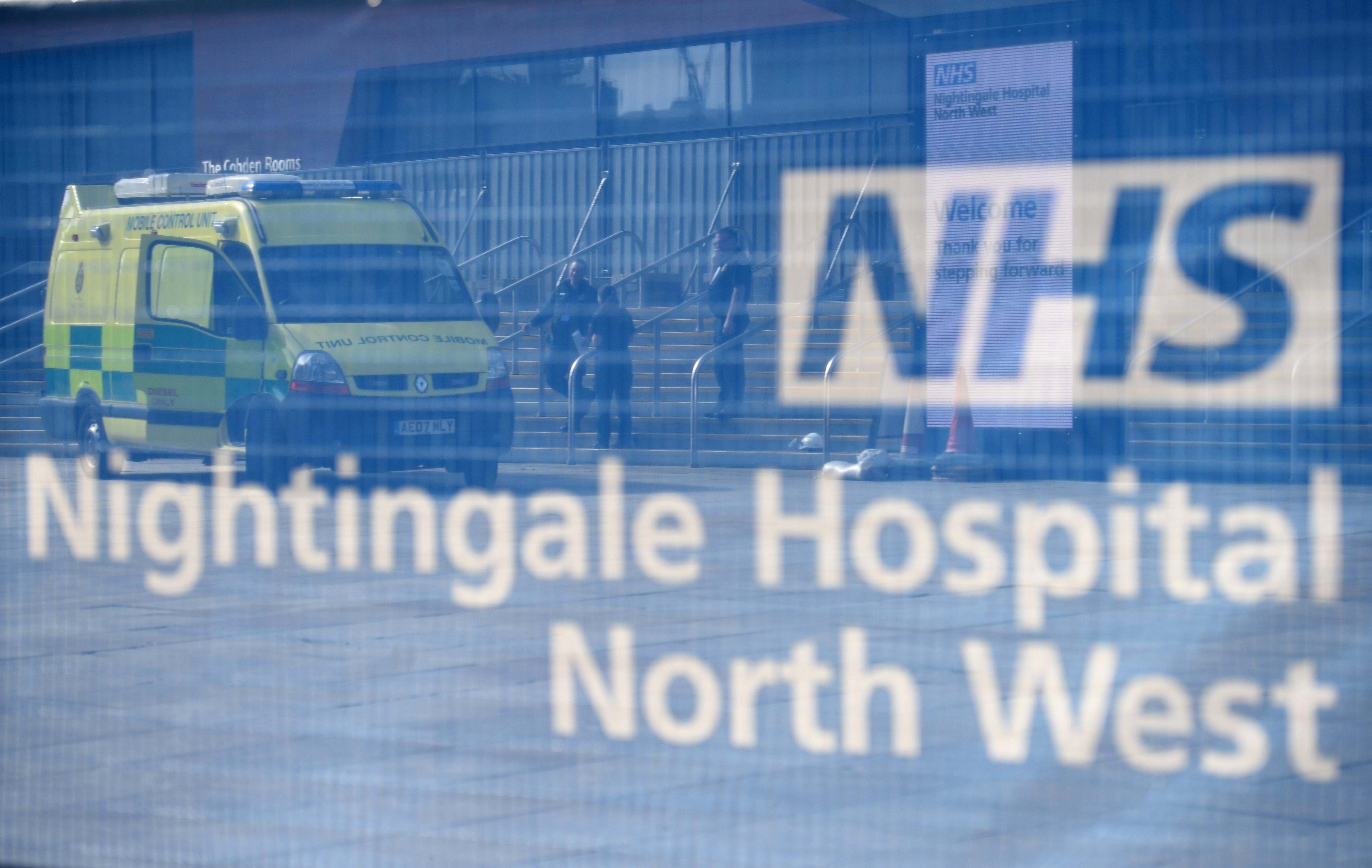 North West Ambulance Service medical staff stand outside Nightingale Hospital North West in Manchester, England, on April 13.