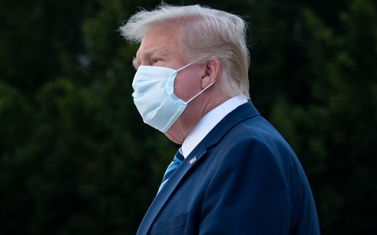 President Donald Trump wears a face mask as he leaves Walter Reed Medical Center in Bethesda, Maryland on October 5, 2020.
