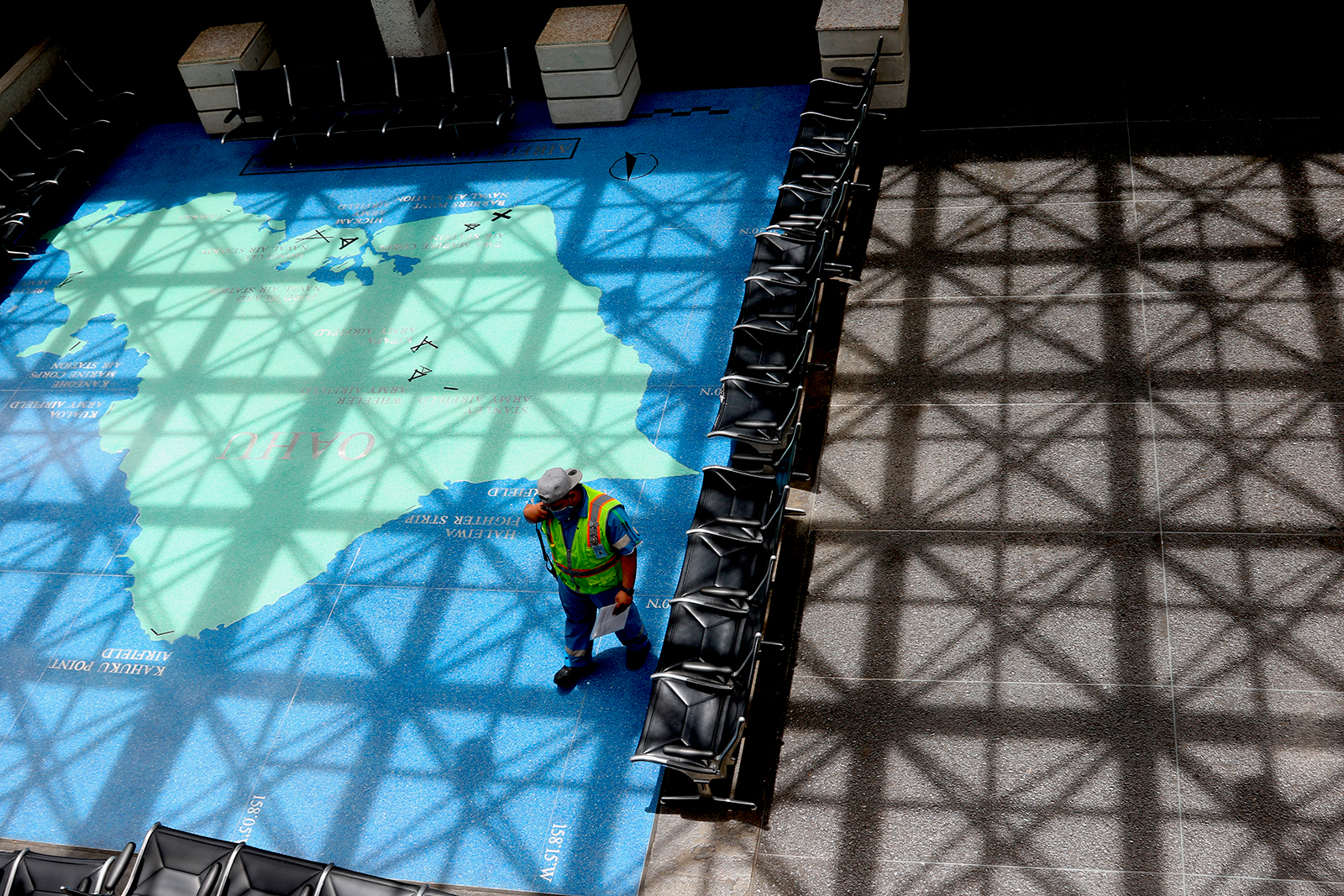 A man stands in an empty waiting area at the international airport on April 21 in Honolulu, Hawaii.
