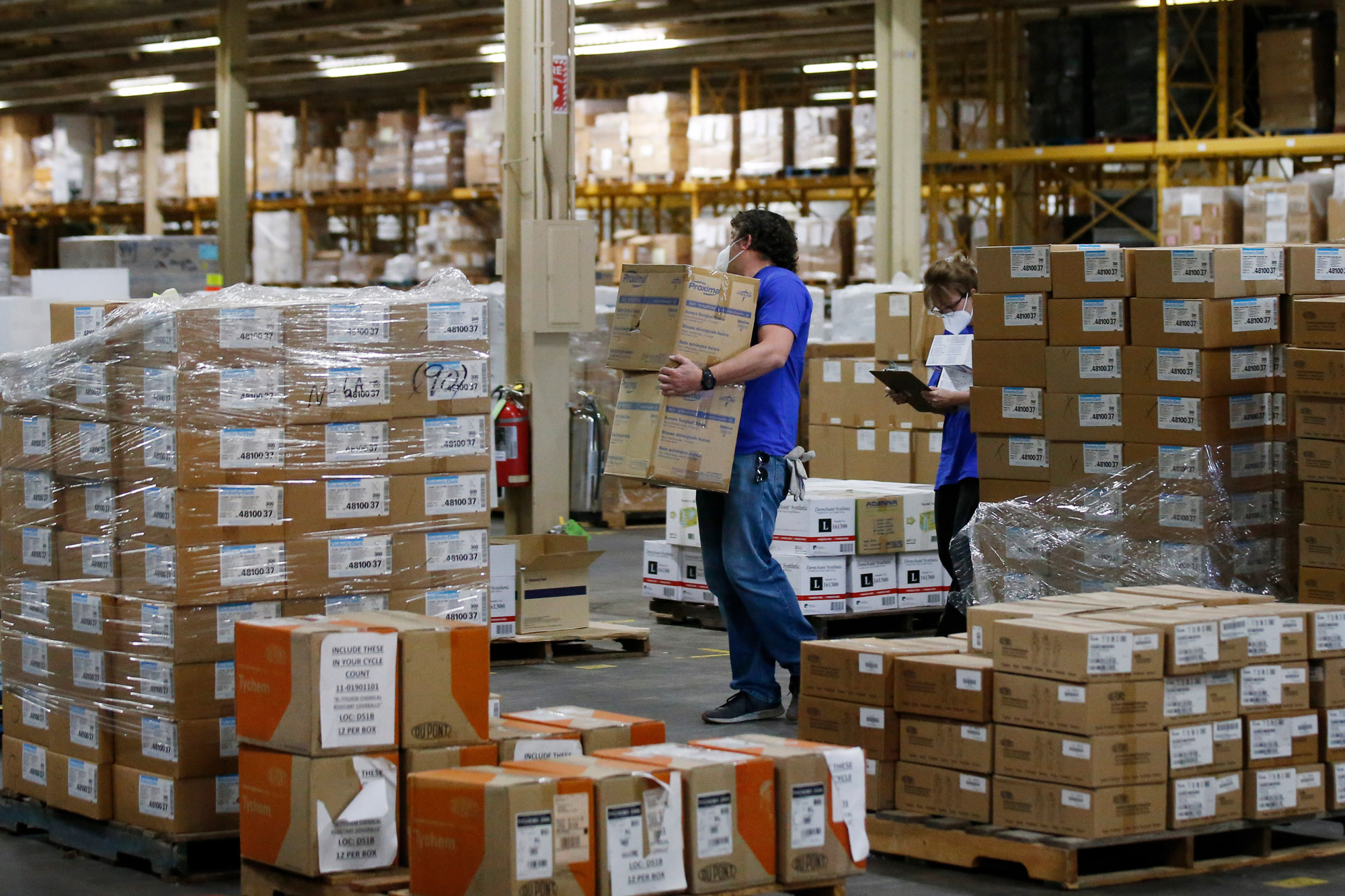 Workers carry boxes at Oklahoma's Strategic National Stockpile warehouse in Oklahoma City on April 7.