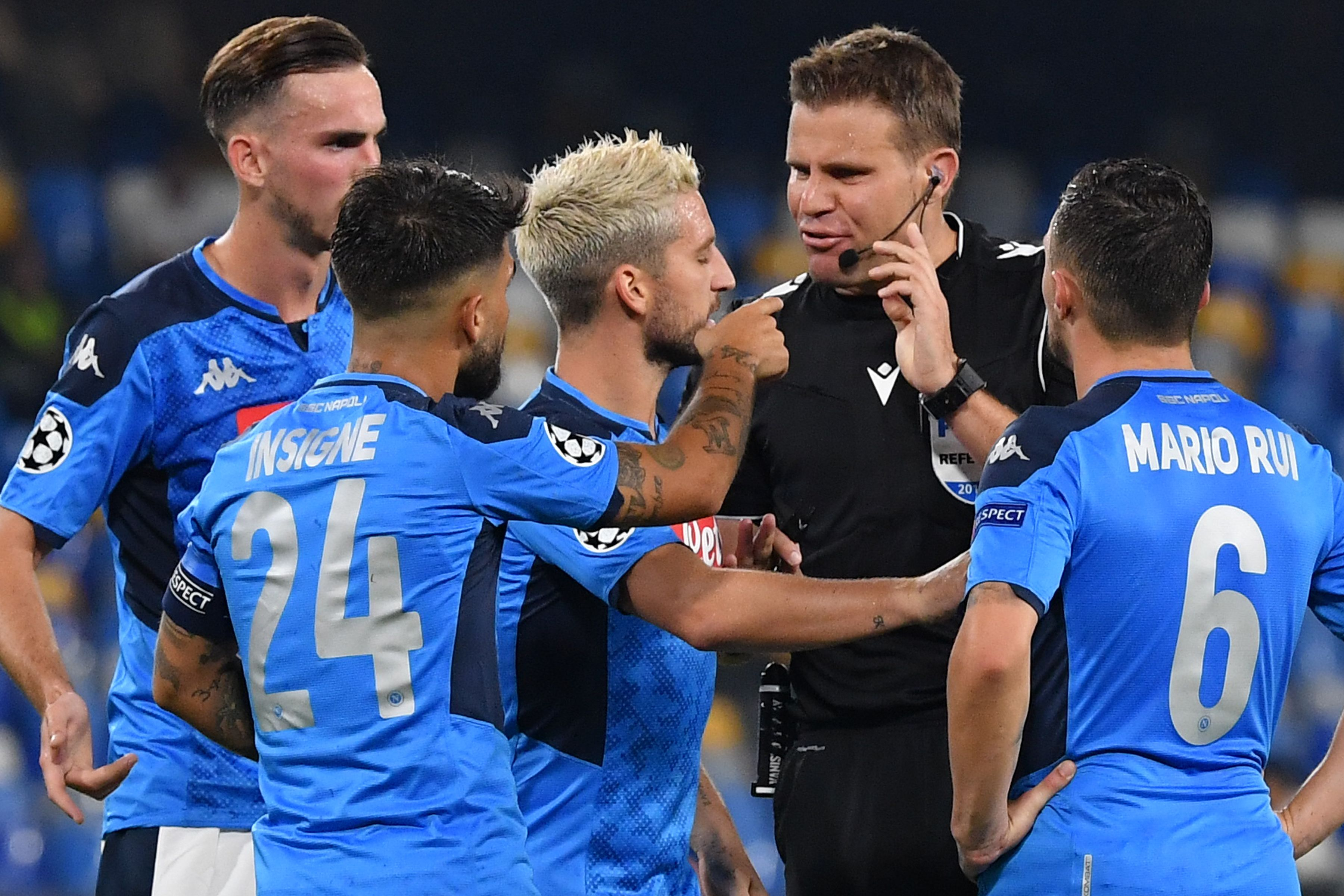 Napoli players remonstrate with the referee