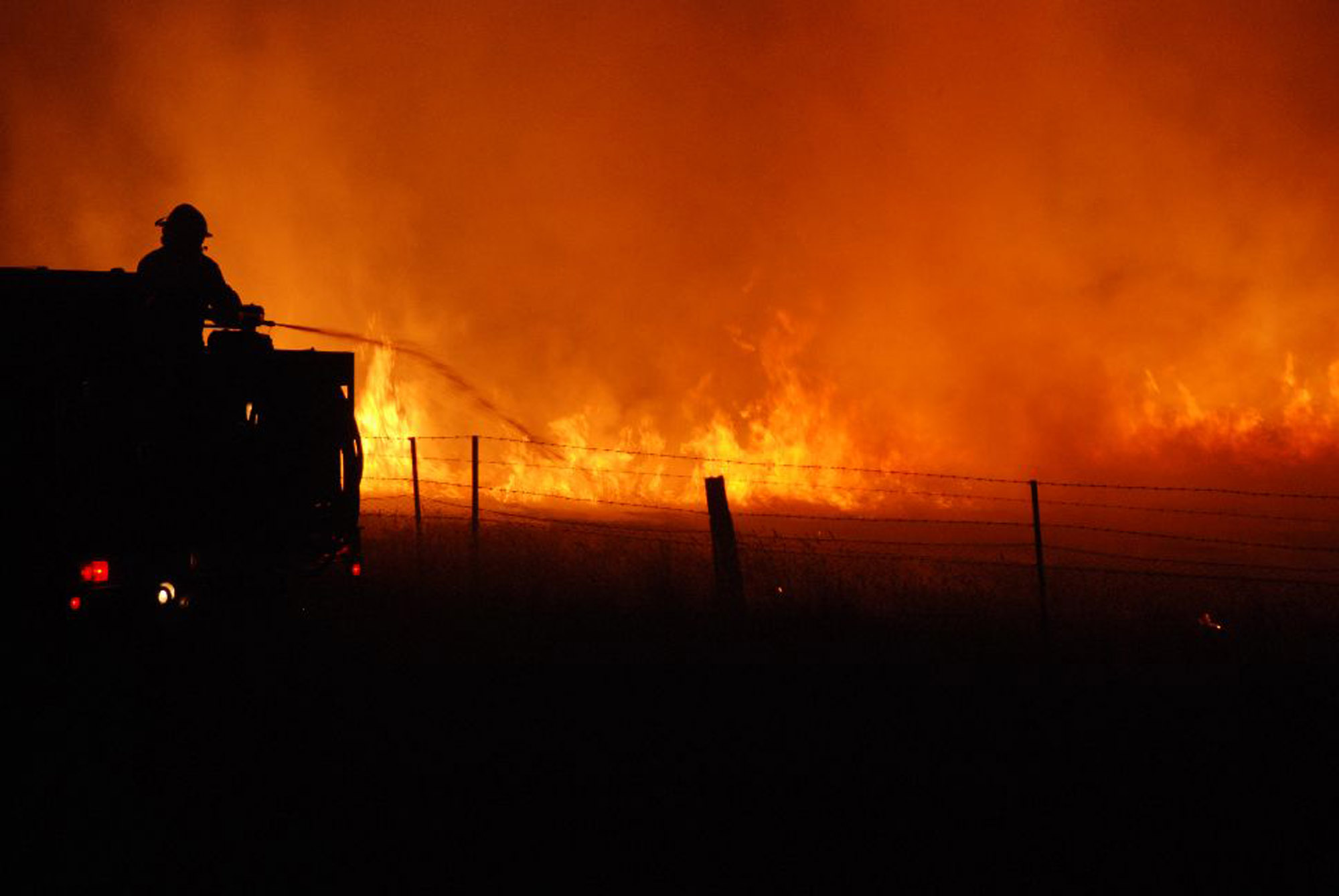 A firefighter battles a blaze in the Victorian township of Taggety on February 7, 2009.