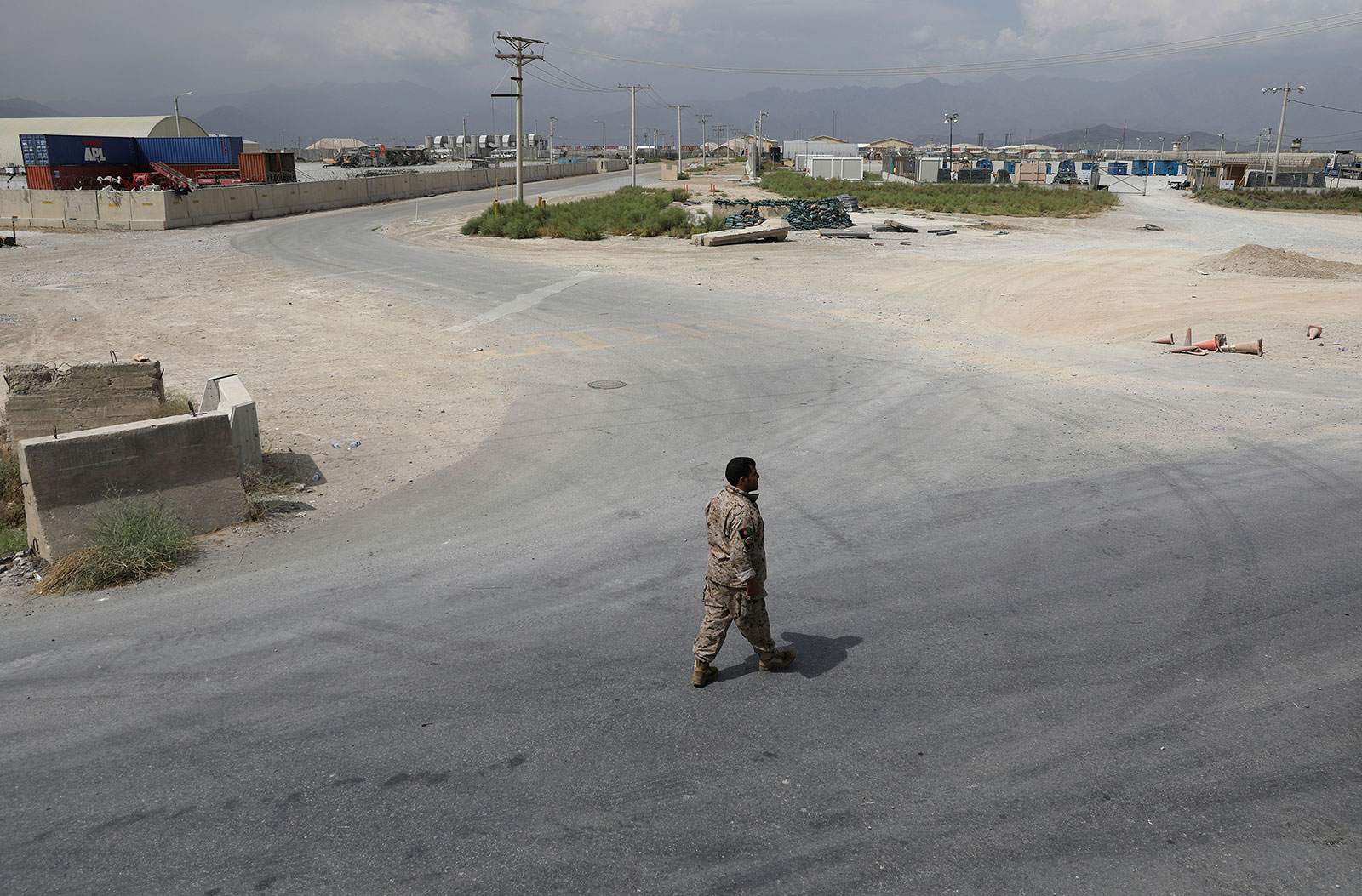 A member of Afghanistan's security forces walks at Bagram Air Base after the last American troopsdeparted the compoundin July 2021.