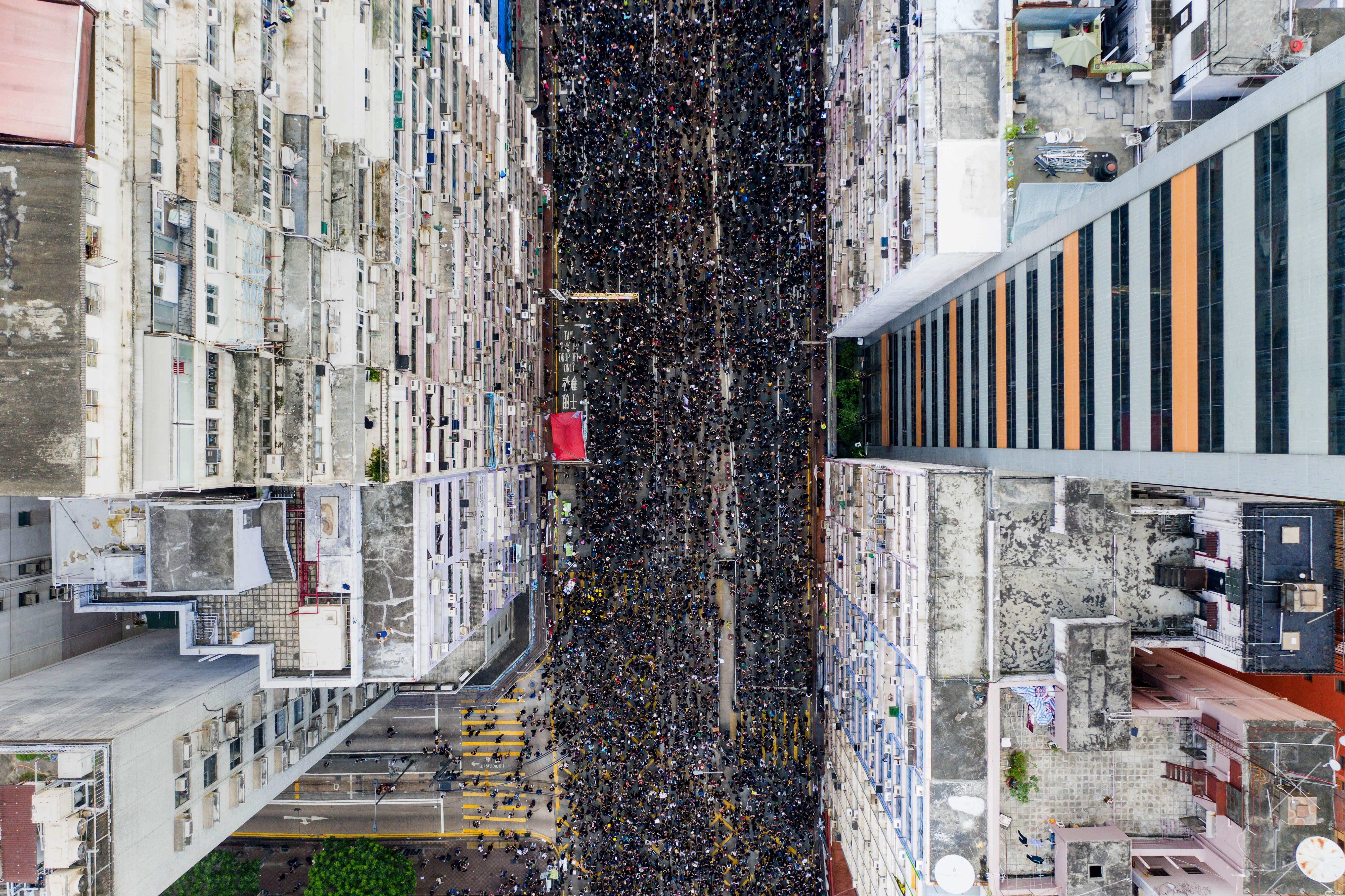 Tens of thousands of protesters march against a proposed extradition law in Hong Kong on June 16, 2019.