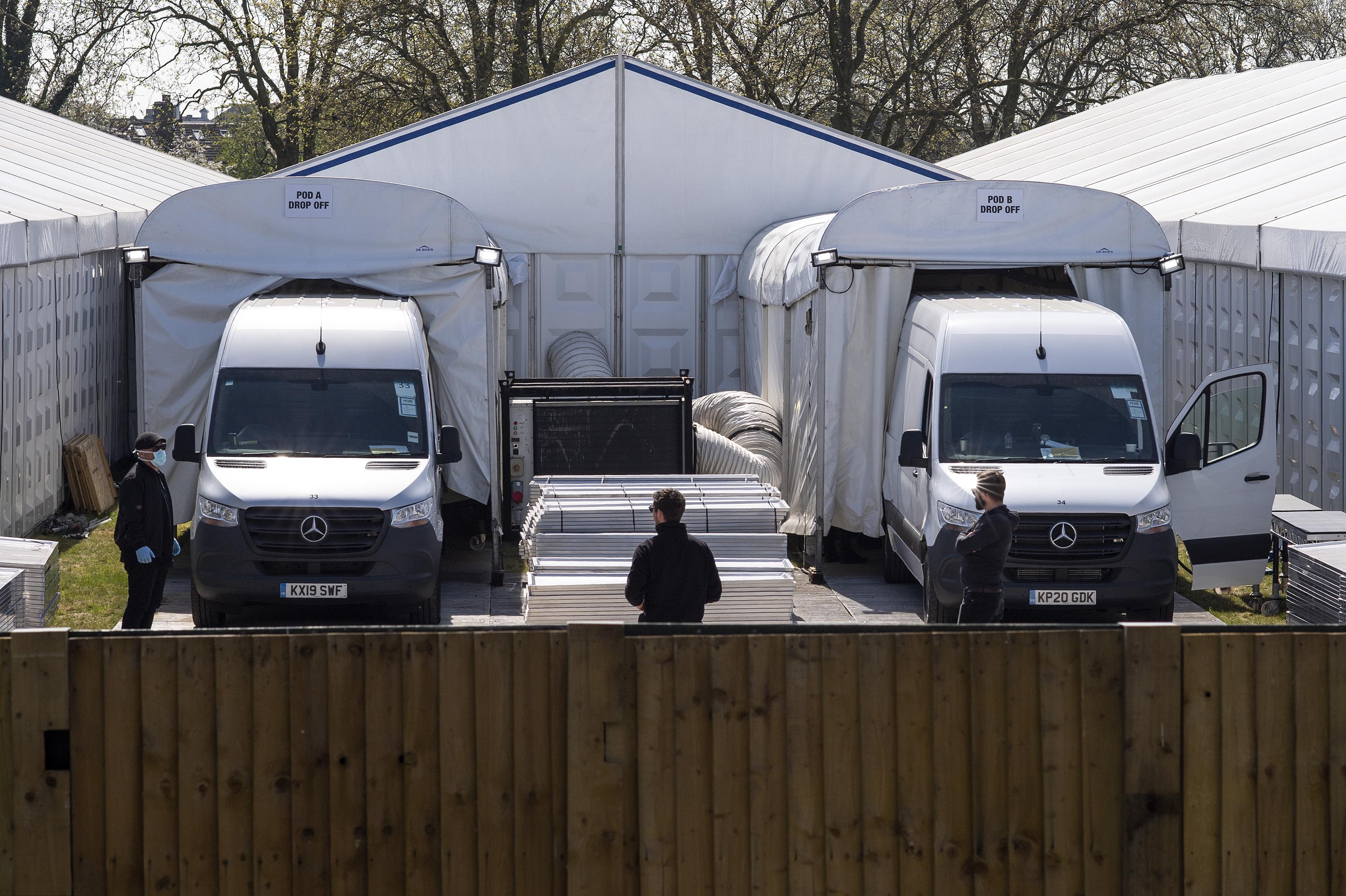 Vans back into drop-off pods at a temporary morgue on Wanstead Flats in London, England, on April 15.