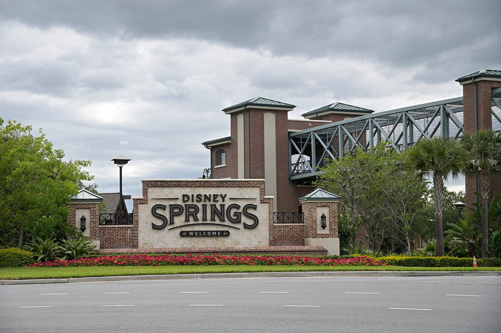An empty street is viewed in front of the Disney Springs shopping and entertainment district, on Monday, April 6, in Lake Buena Vista, Florida.