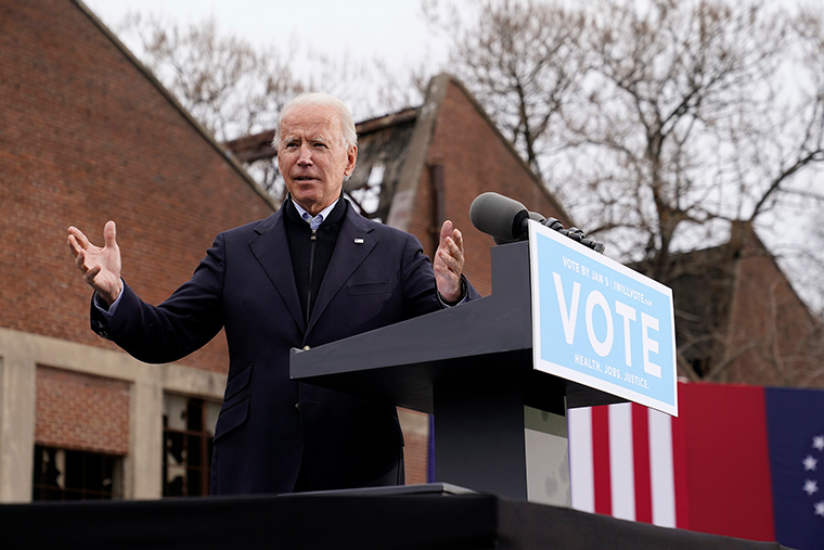 President-elect Joe Biden speaks at a drive-in rally for Georgia Democratic candidates for US Senate Raphael Warnock and Jon Ossoff, Tuesday, December 15, in Atlanta.