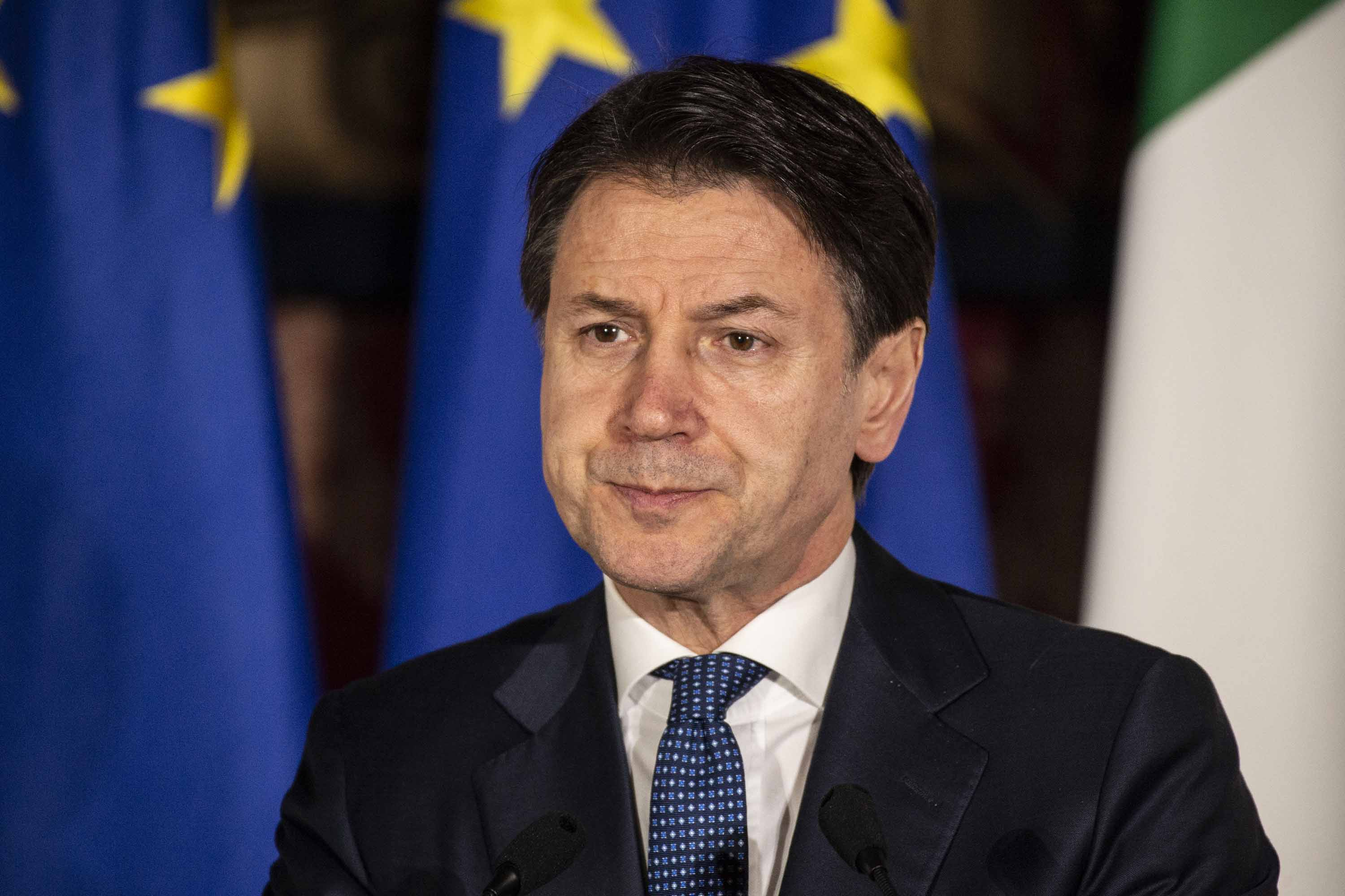 Italian Prime Minister Giuseppe Conte appears at a press conference on February 27 in Naples, Italy.