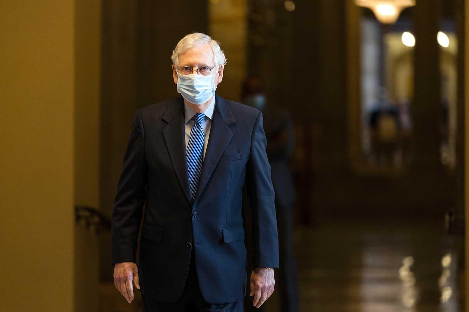 Senate Majority Leader Sen. Mitch McConnell walks towards the Senate floor on Capitol Hill on Thursday, Oct. 1, in Washington.