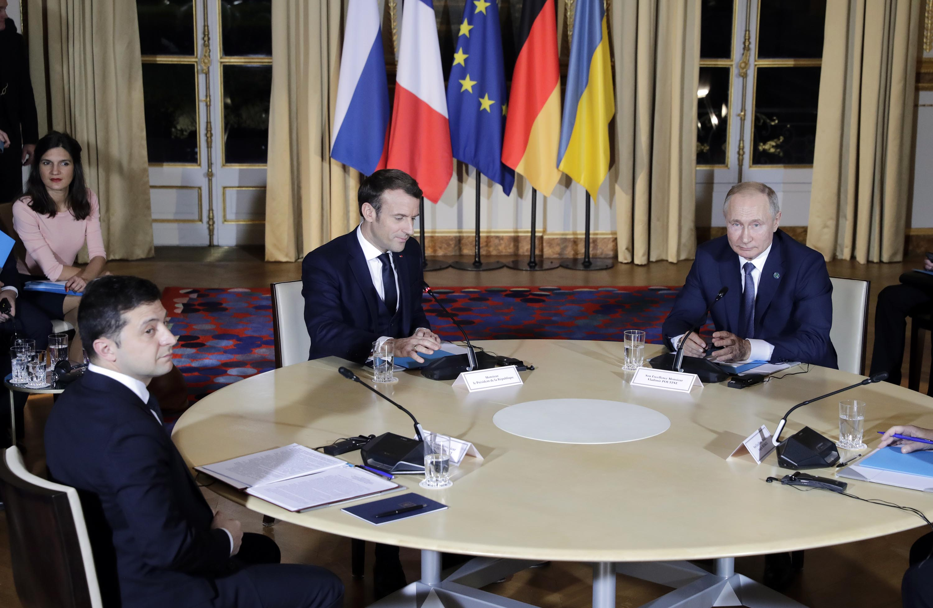 Ukraine's President Zelensky, France's President Macron, and Russia's President Putin (L-R seated) attend a Normandy Four summit in the Elysee Palace on December 9.
