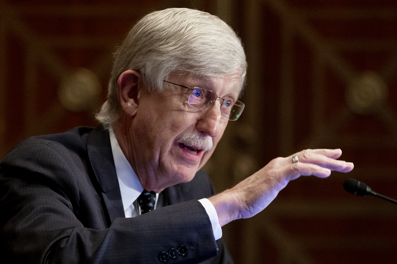 Dr. Francis Collins, director of the National Institutes of Health, appears before a Senate Health, Education, Labor, and Pensions Committee hearing to discuss vaccines and protecting public health during the coronavirus pandemic on Sept. 9, in Washington.