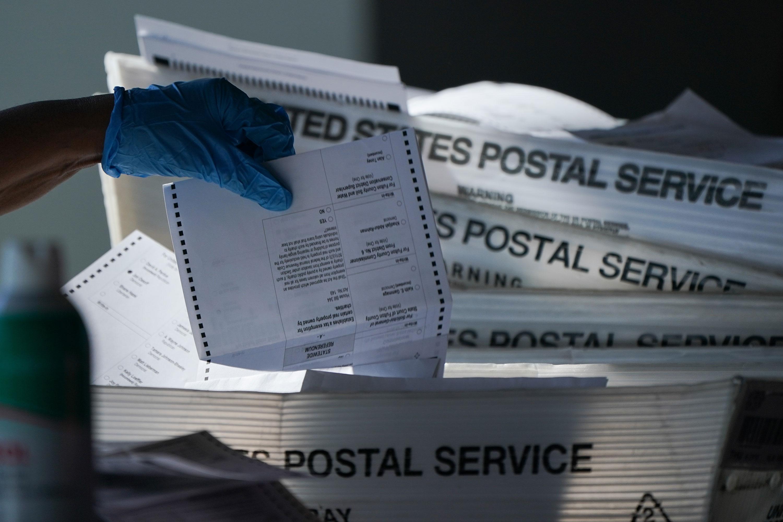 An election official counts absentee ballots in Atlanta on November 4.