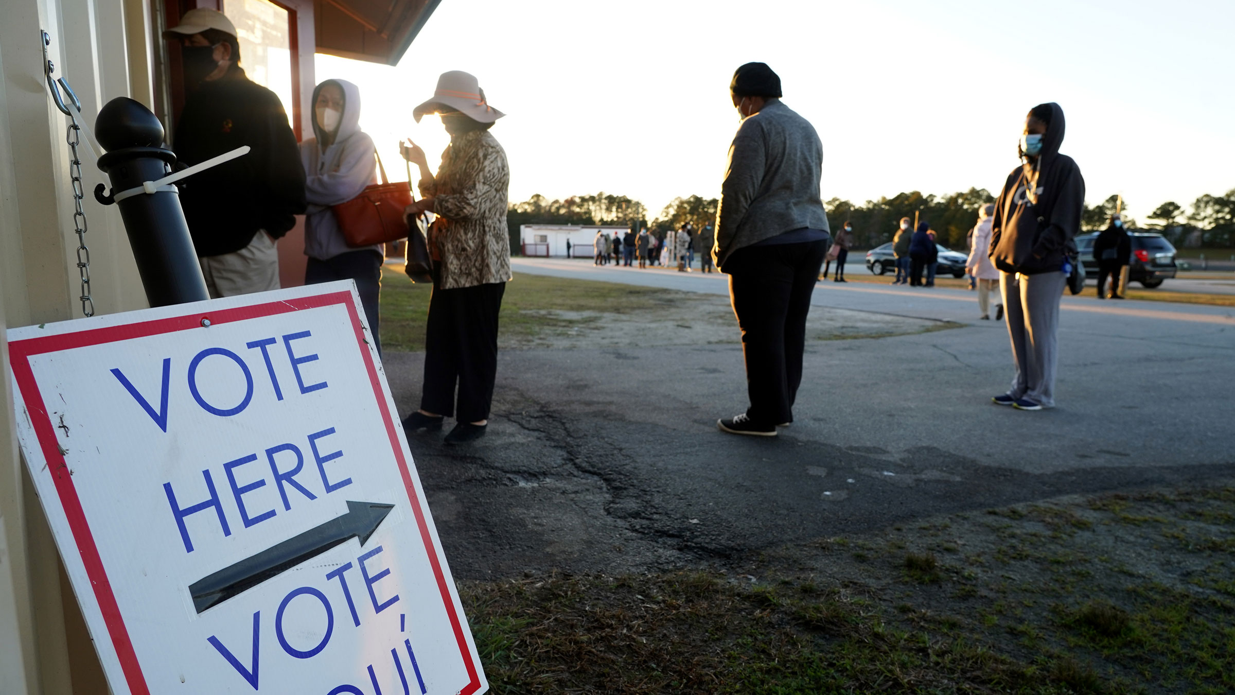 Voters stand in line in Atlanta to cast their ballots during the first day of early voting on December 14.