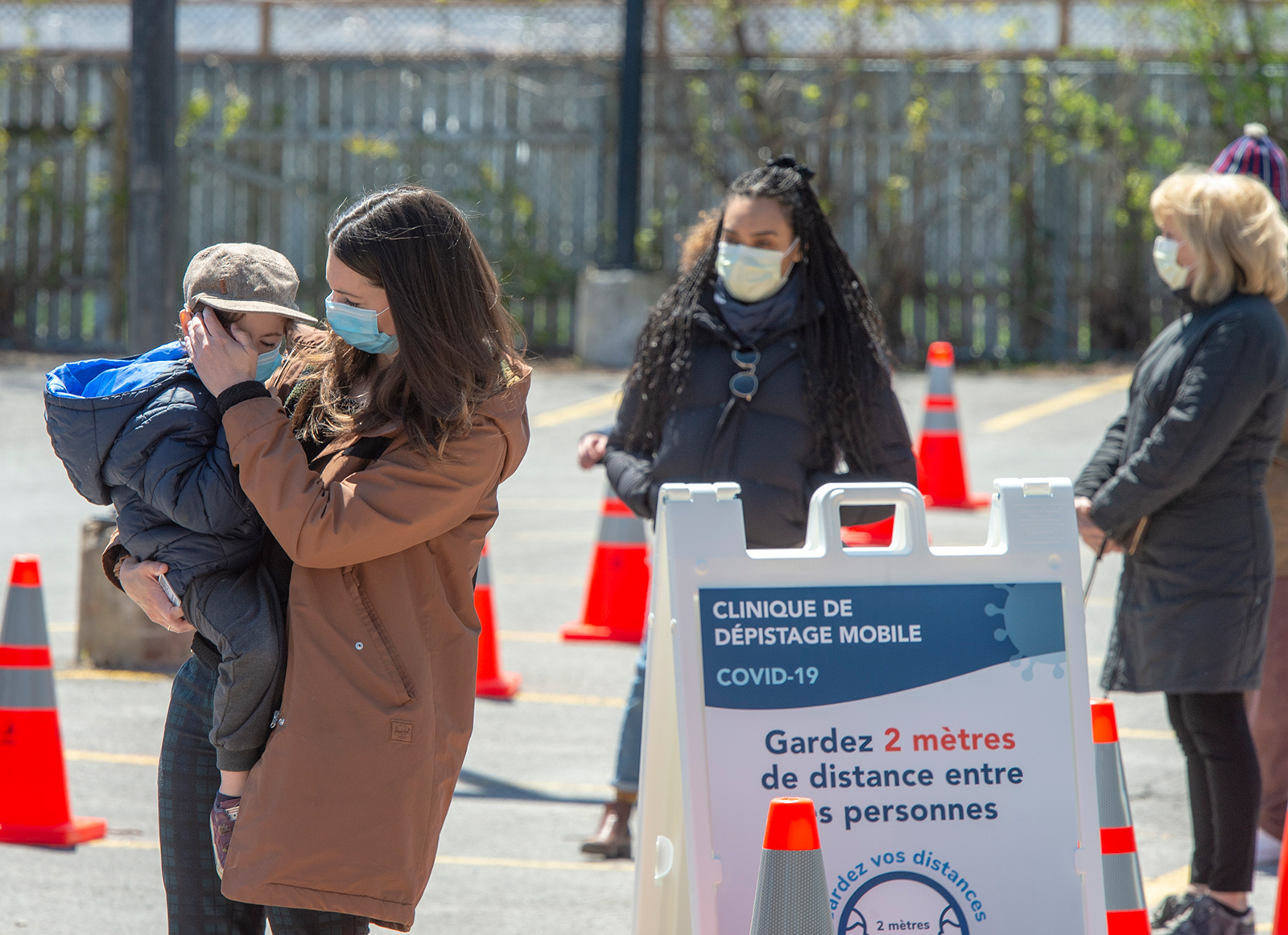 People wait in line at a mobile Covid-19 testing clinic on May 12, in Montreal.