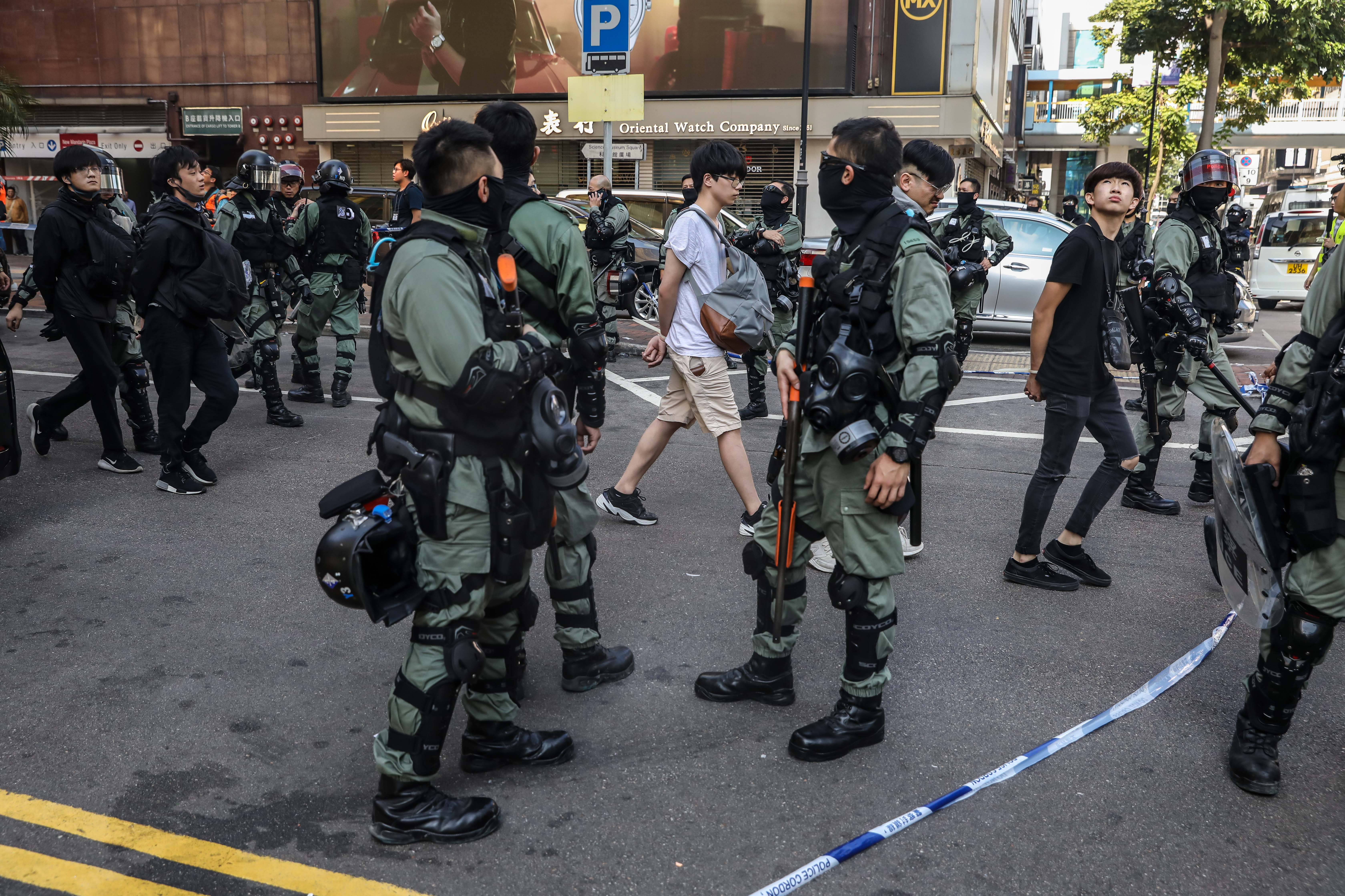 People are detained by police near the Hong Kong Polytechnic University in Hung Hom district of Hong Kong on November 18.