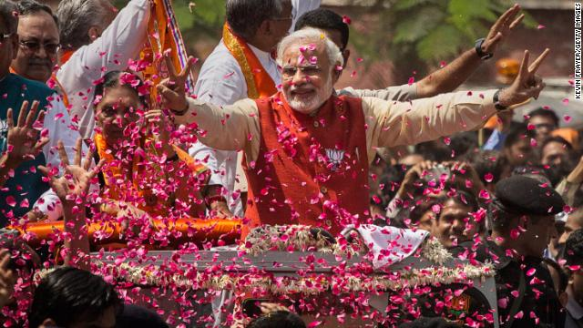 Supporters throw flower petals at Narendra Modi on April 9, 2014 in Vadodra, India.
