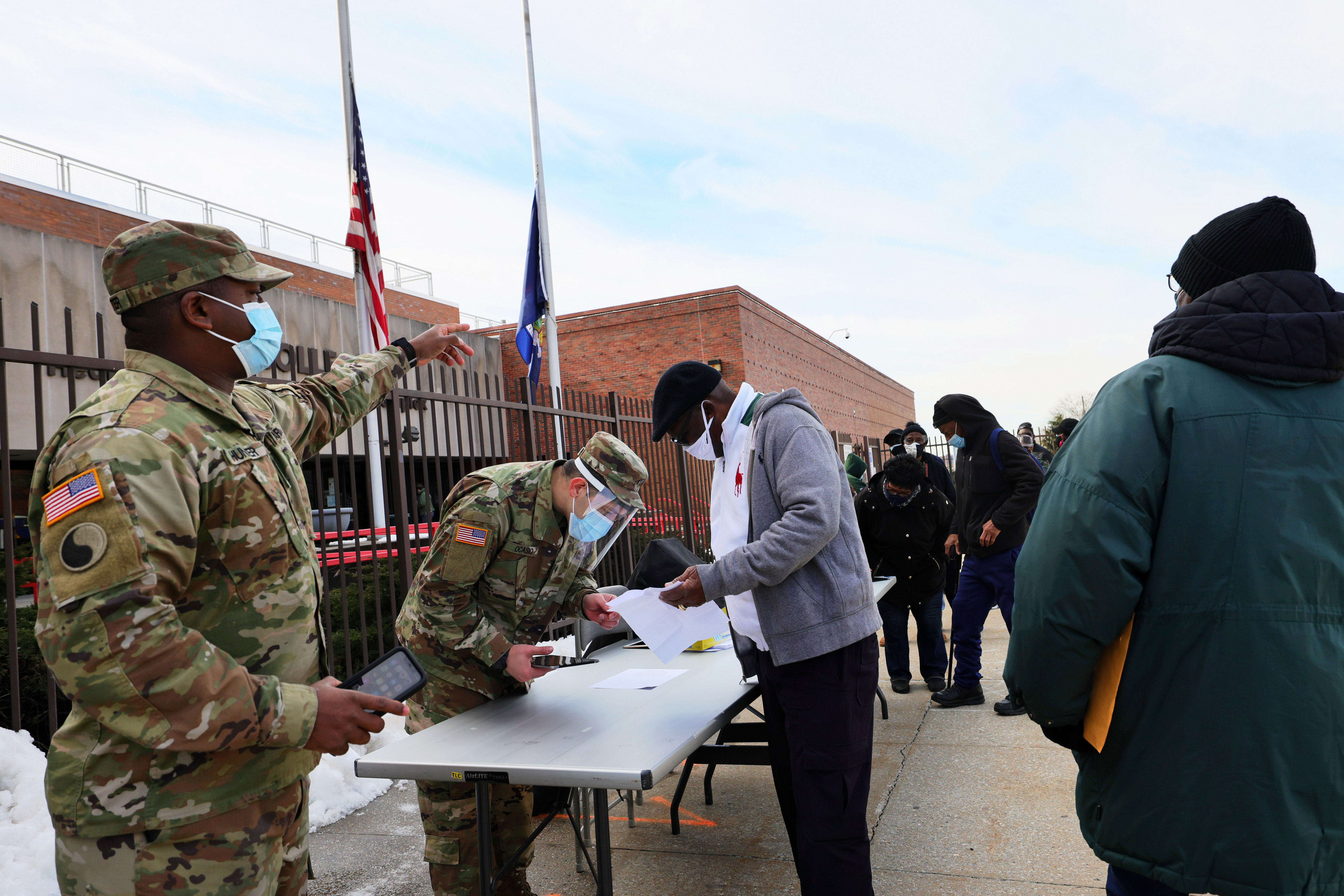 Members of the National Guard help people sign up for their Covid-19 vaccination appointments at York College in Queens, New York, on February 24.