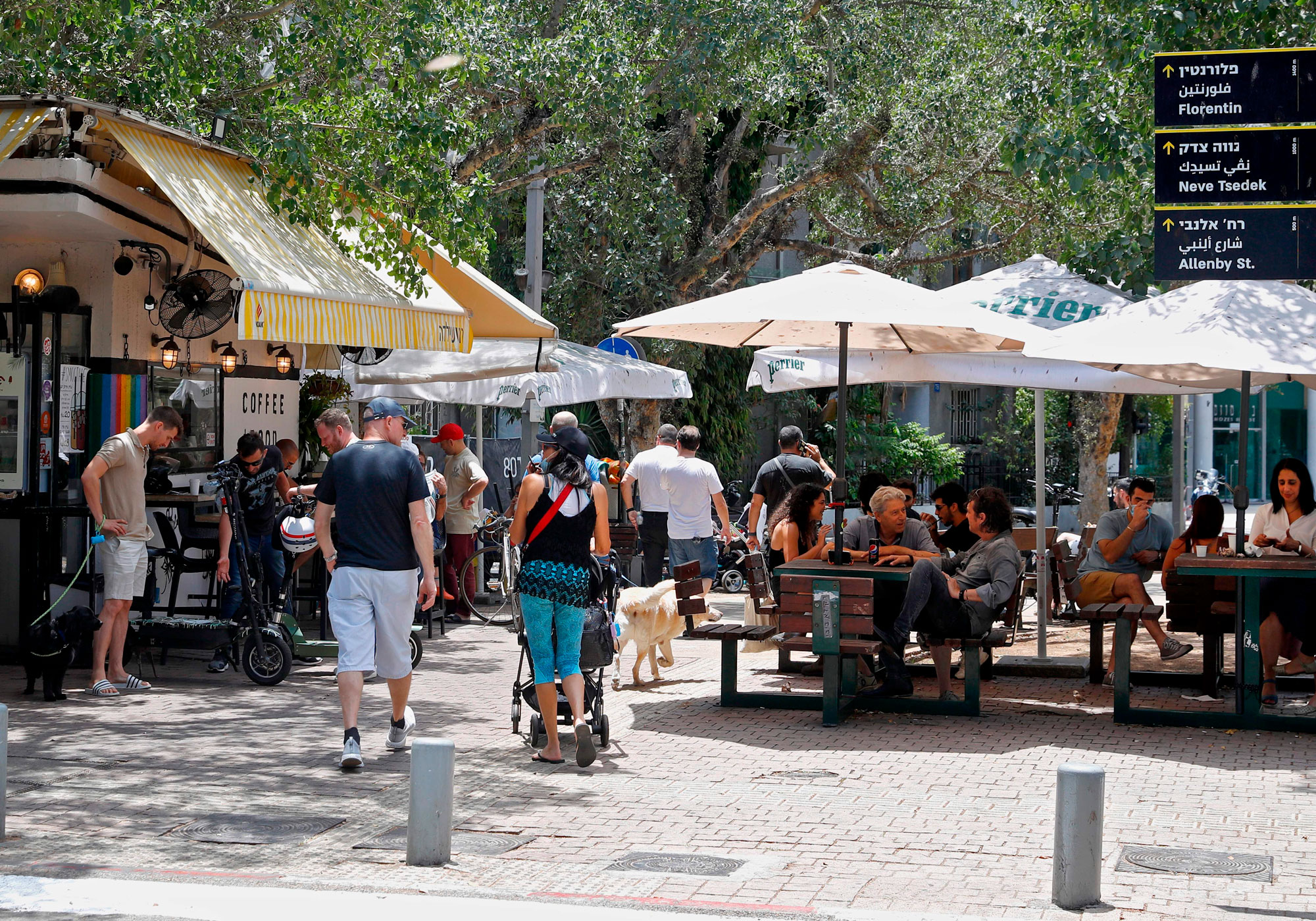 People sit outside a cafe in Israel's Mediterranean coastal city of Tel Aviv, Israel, on May 27.