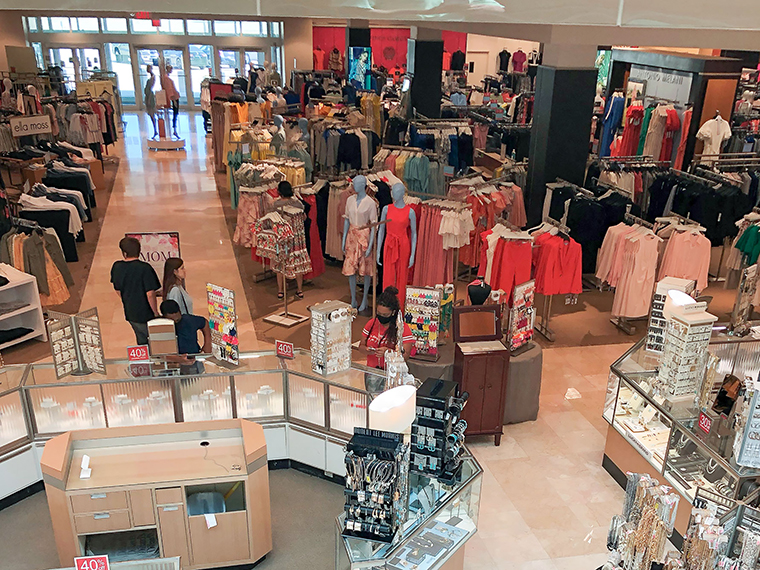 Customers shop at a shopping mall in Frisco, Texas, on Tuesday, May 5. The shopping mall reopened with shortened business hours on Tuesday.