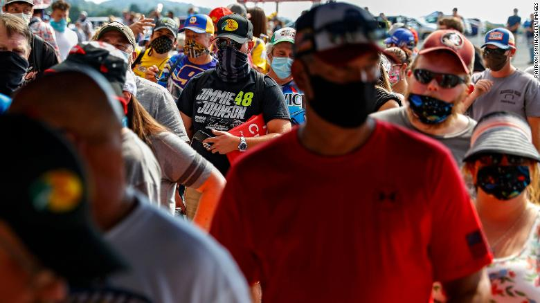 Fans wearing face masks and face coverings enter the race track prior to the NASCAR Cup Series All-Star Race at Bristol Motor Speedway on July 15 in Bristol, Tennessee.