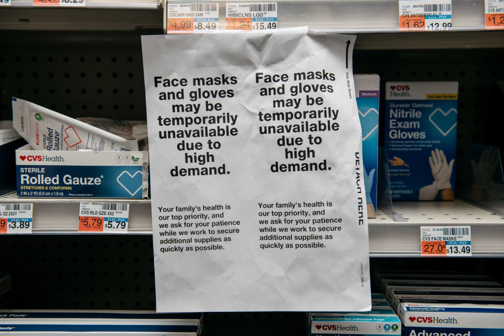 Amid fears of a growing coronavirus pandemic, signs for sold-out face masks are posted Wednesday in a New York pharmacy.