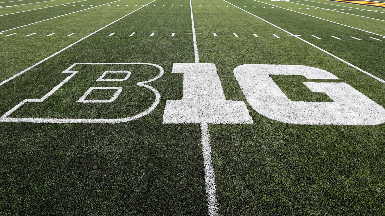 In this August 31, 2019 file photo, the Big Ten logo is displayed on the field before an NCAA college football game between Iowa and Miami of Ohio in Iowa City.