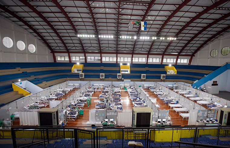 COVID-19 patients lie on beds in a field hospital built inside a gym in Santo Andre, on the outskirts of Sao Paulo, Brazil, on June 9.
