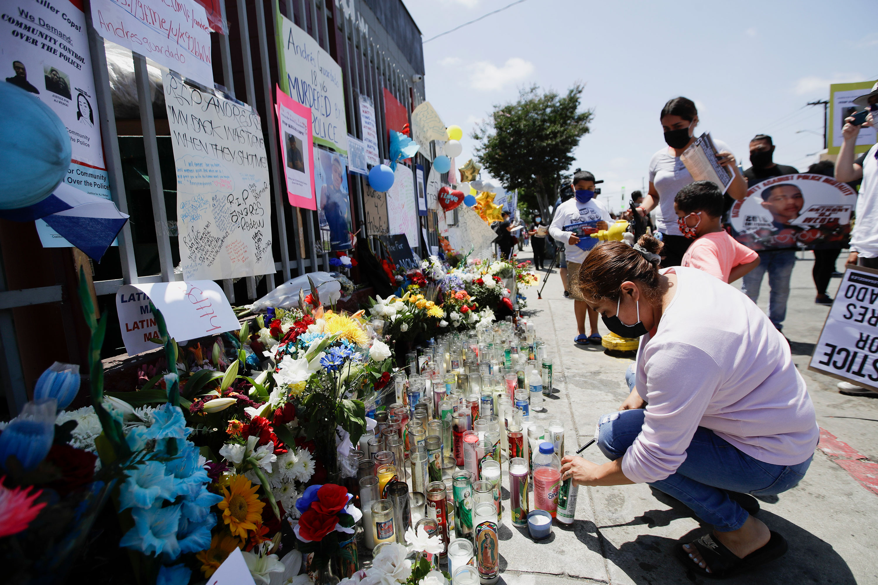 People leave candles and other items at a makeshift memorial for Andres Guardado on June 21 in Gardena, California.