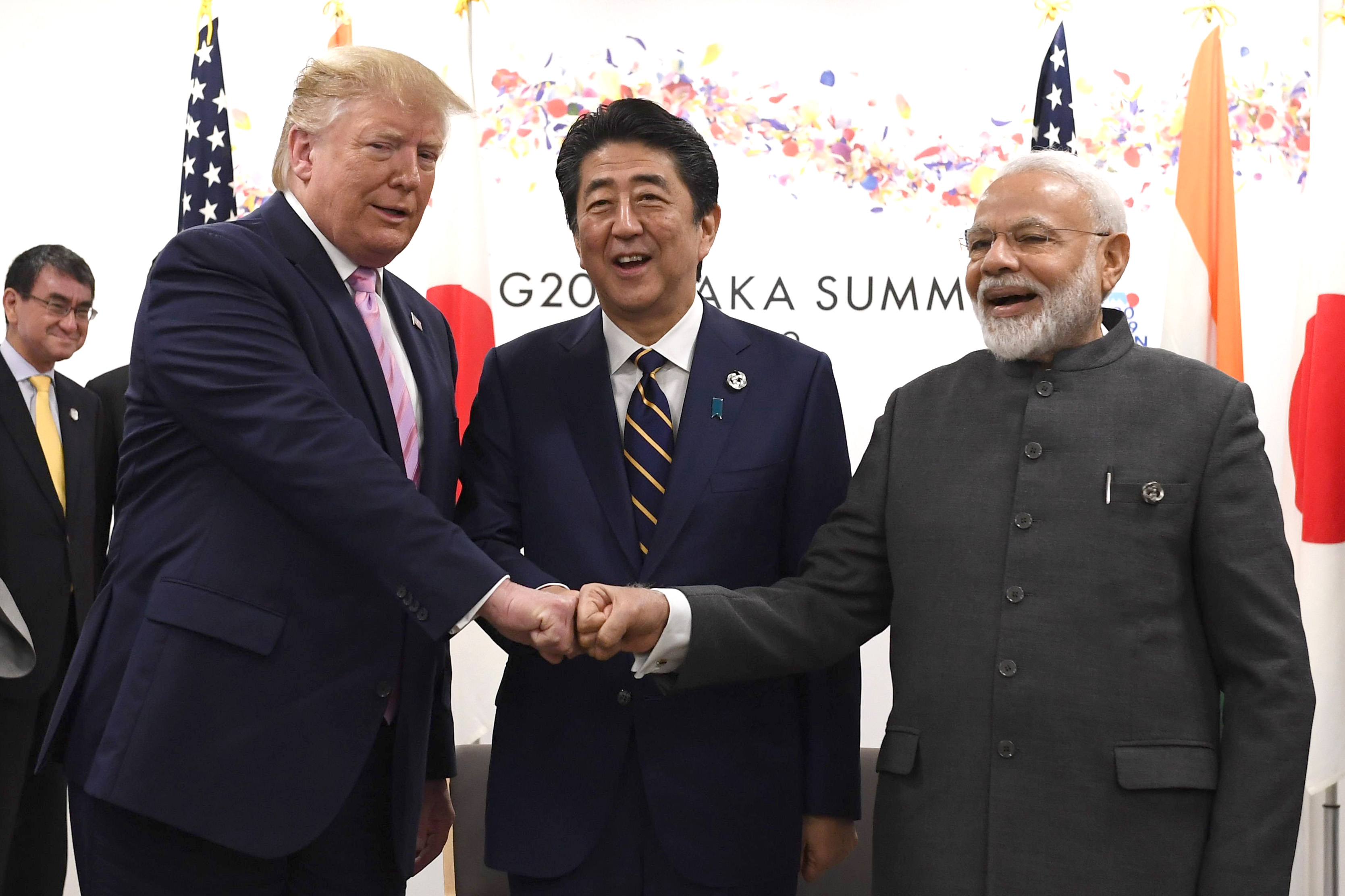 US President Donald Trump, Japanese Prime Minister Shinzo Abe, and Indian Prime Minister Narendra Modi share a fist bump at their trilateral meeting.