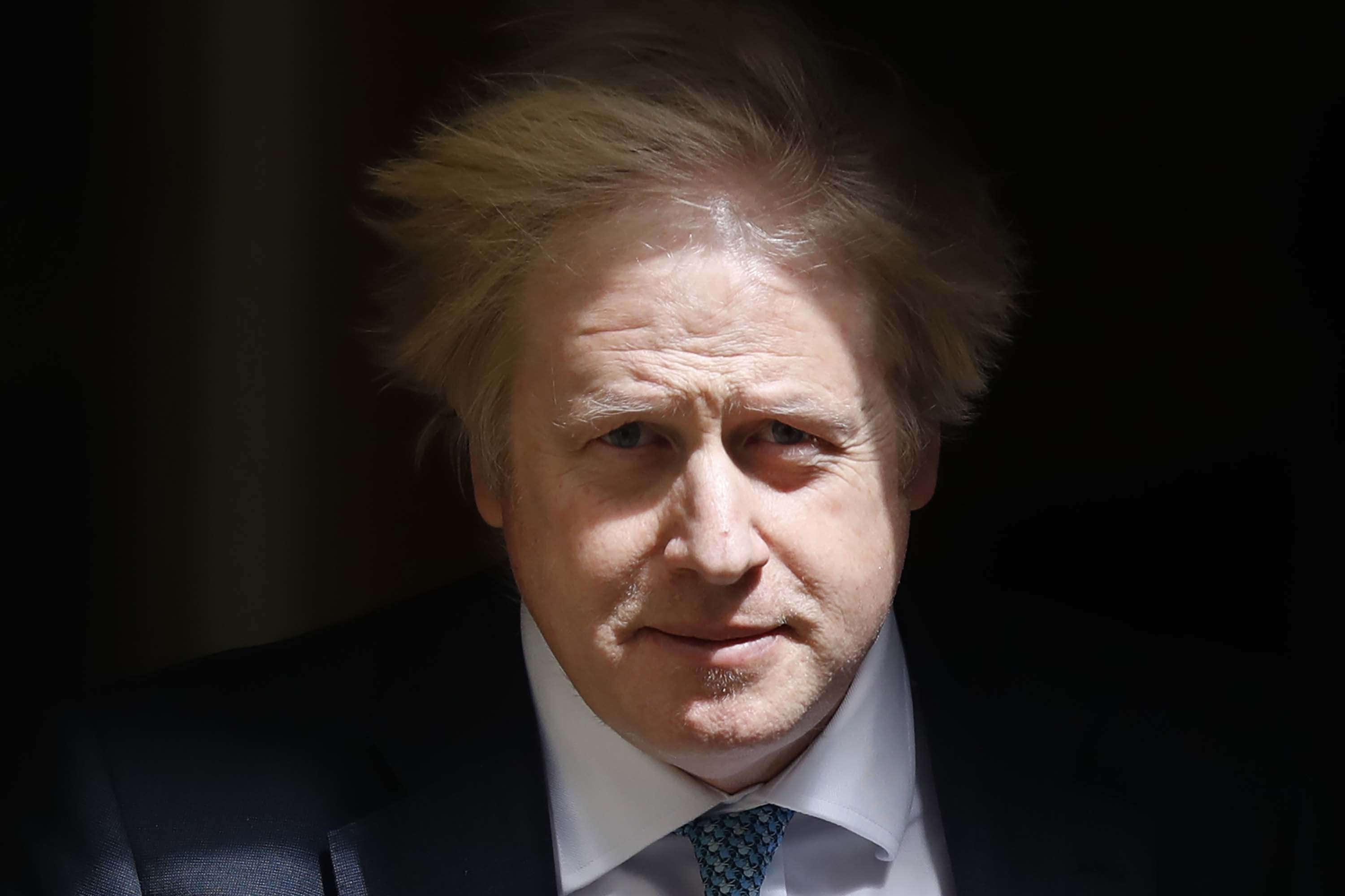 Britain's Prime Minister Boris Johnson leaves 10 Downing Street to attend Prime Minister's Questions in the Houses of Parliament on May 13 in London.