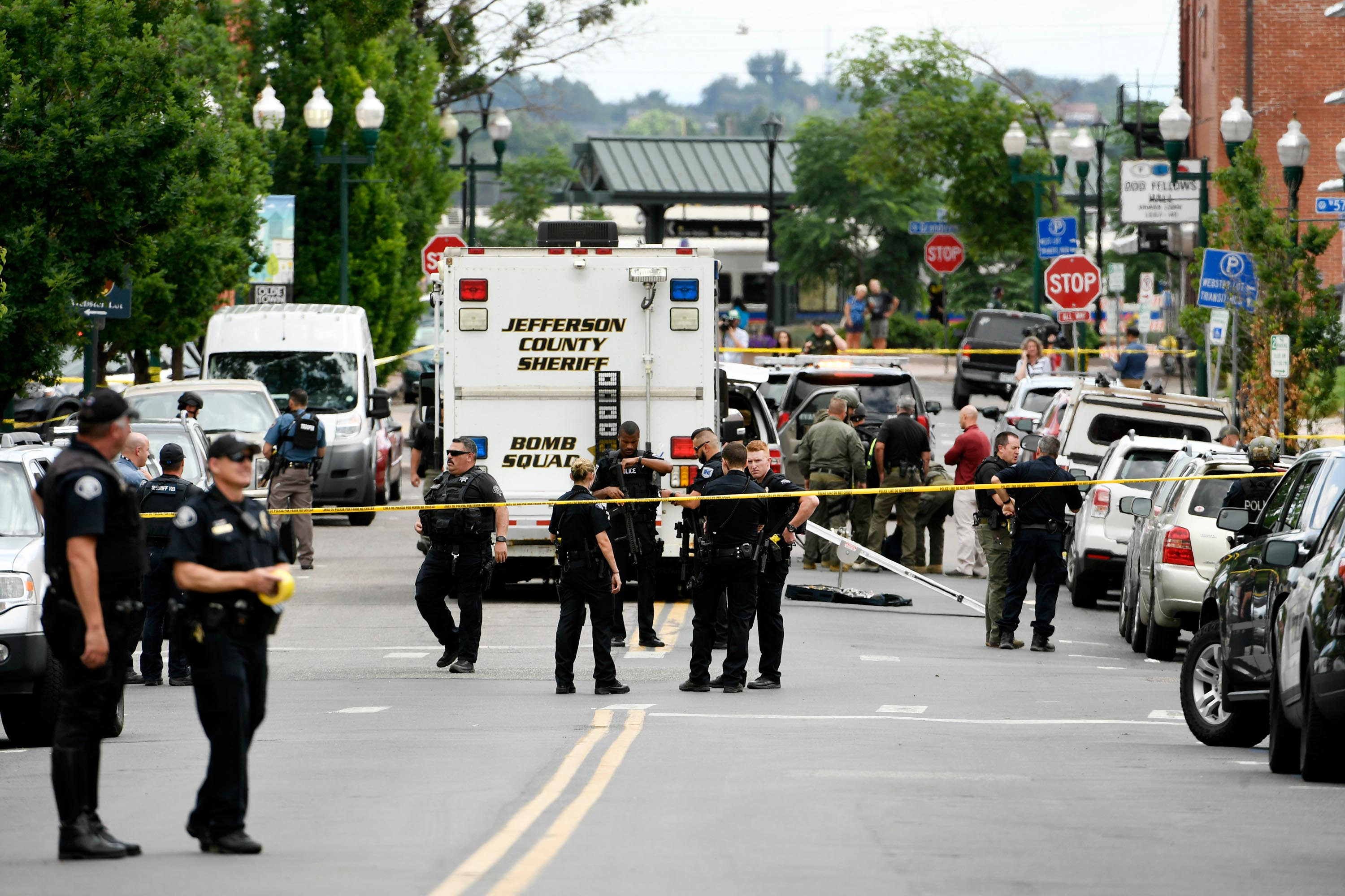 Police officers investigate the scene of an early afternoon shooting in Olde Town Arvada on June 21, 2021 in Arvada, Colorado.
