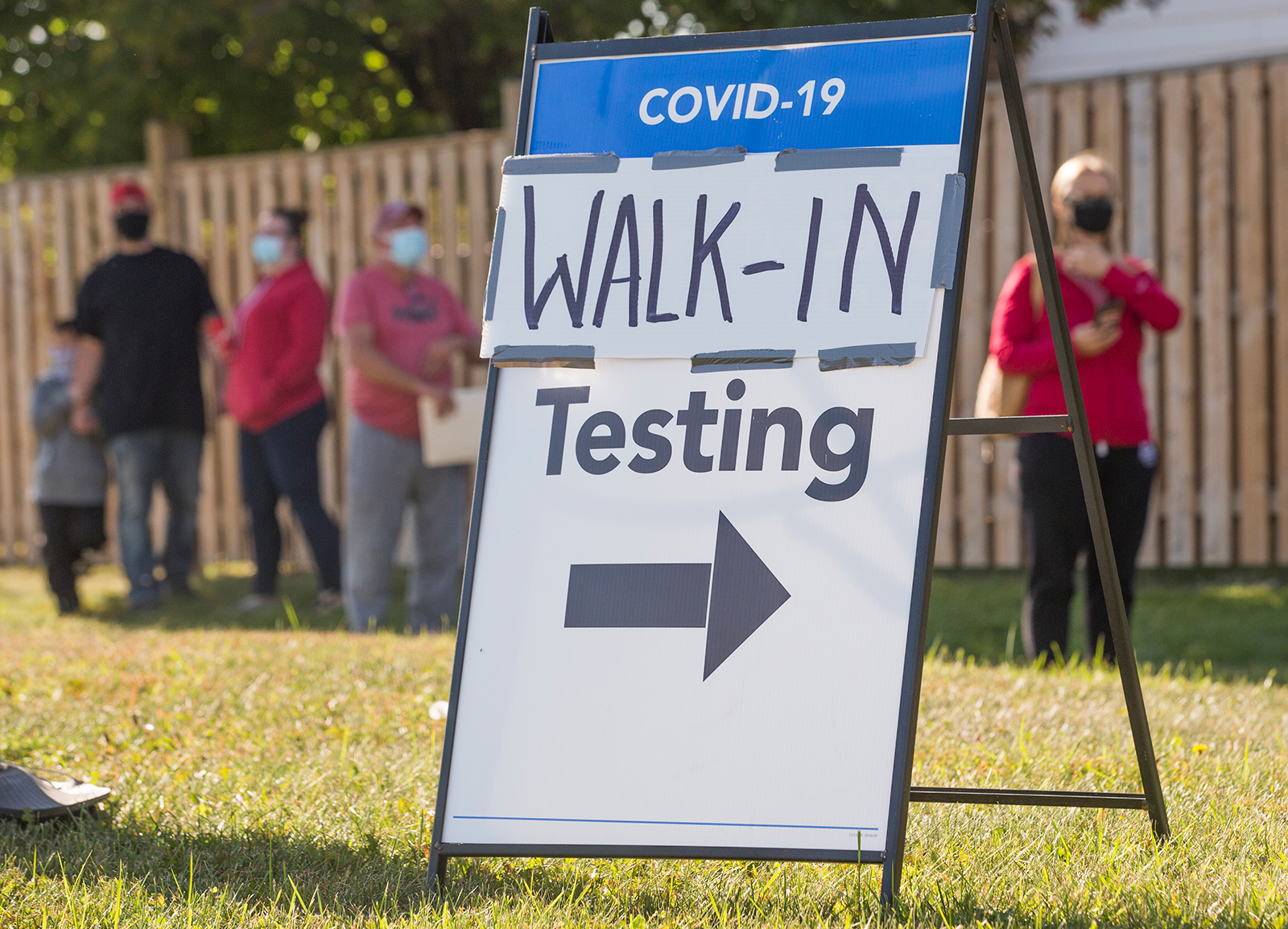 People wait in line for a Covid-19 test center in Brampton, Ontario, Canada, on September 21.
