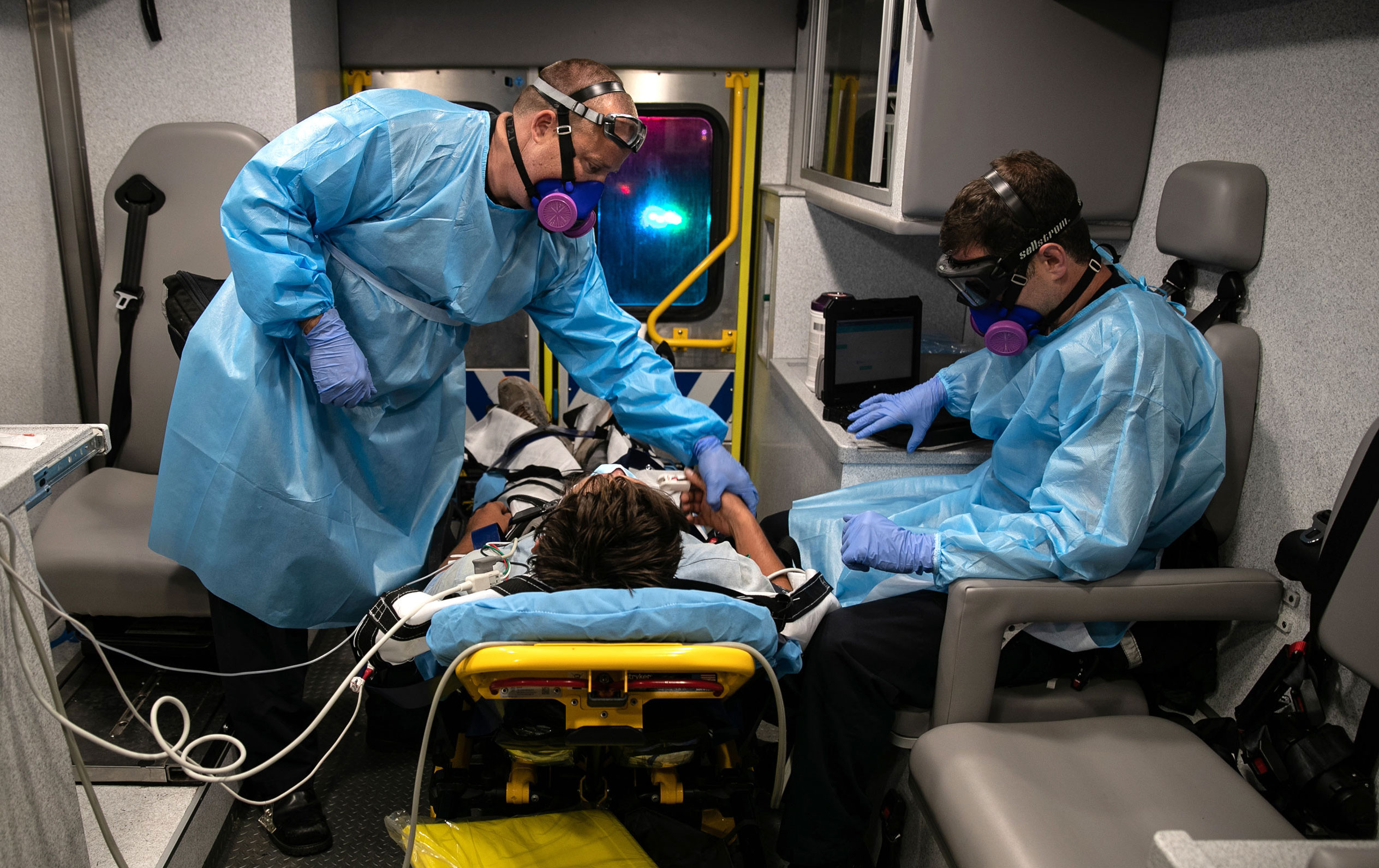 Medics with Austin-Travis County EMS transport a patient to a hospital on August 4 in Austin, Texas.