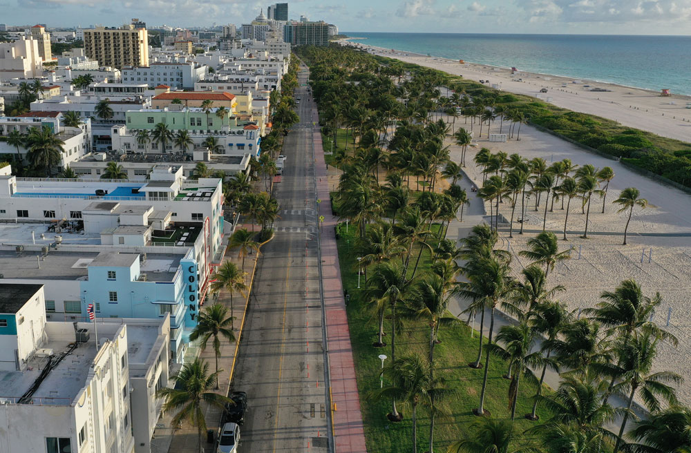 In this aerial view from a drone,desolate Ocean Drive is seen after most visitors have checked out of their hotels in a citywide effort to contain the coronavirus on March 24, in Miami Beach, Florida.