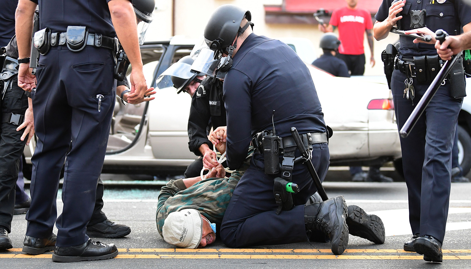 A man is arrested by Los Angeles police officers for violating curfew in Hollywood, California on June 2.
