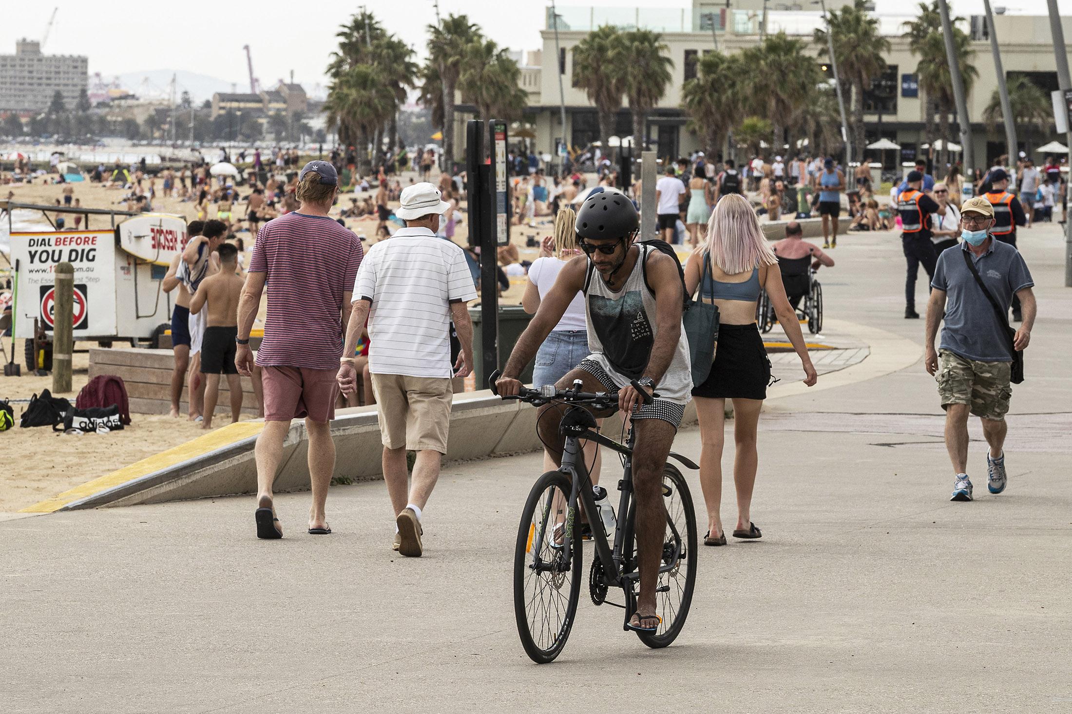 People enjoy the weather at St. Kilda beach on Nov. 27, in Melbourne, Australia.