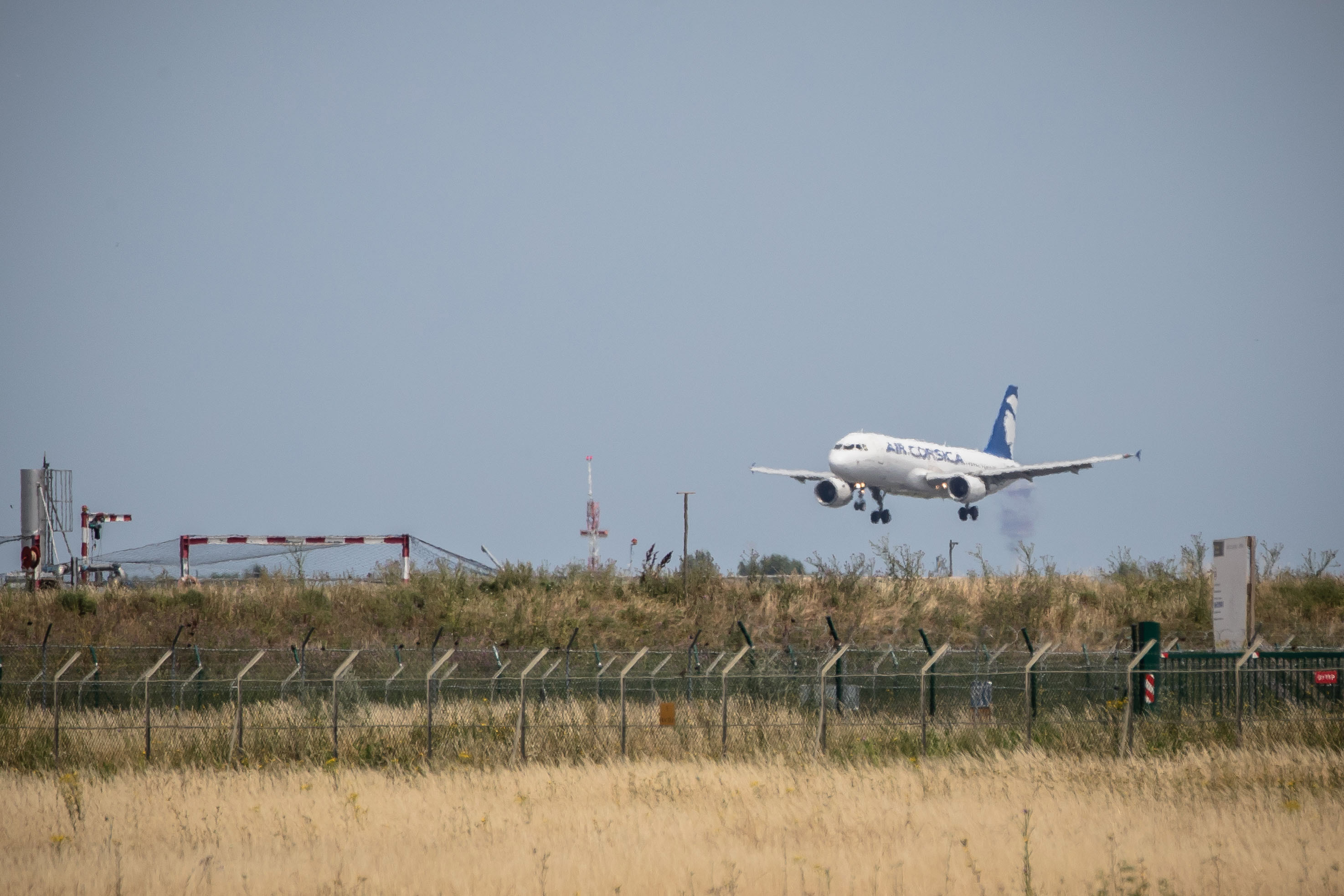 An Air Corsica aircraft lands at Paris Orly Airport near Paris on June 26.