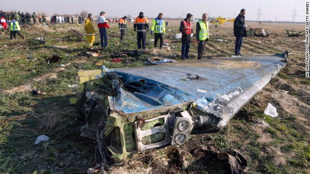 Rescue teams are seen on Jan. 8 at the scene of a Ukrainian airliner that crashed shortly after take-off near Imam Khomeini airport in the Iranian capital Tehran.