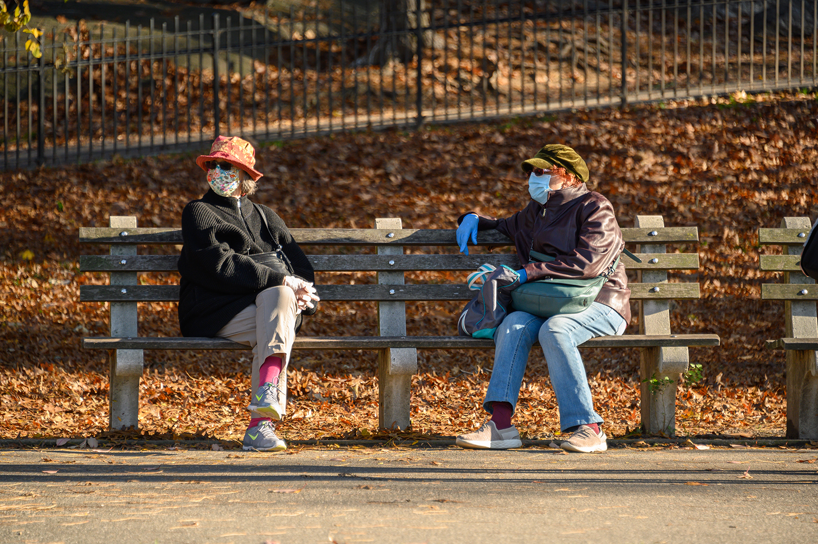 People wear face masks and rubber gloves in Riverside Park on November 14 in New York.