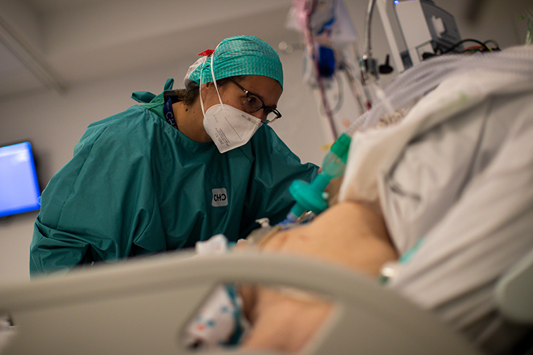 A member of the medical team works in the intensive care ward for COVID-19 patients at the MontLegia CHC hospital in Liege, Belgium, Friday, Nov. 6, 2020.