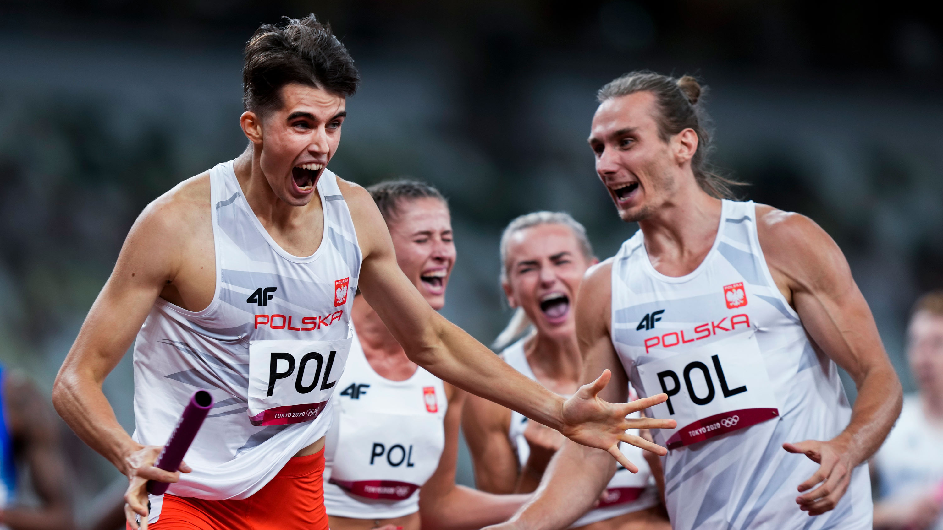 Team Poland celebrates after winning the 4x400 meter mixed relay final on July 31.