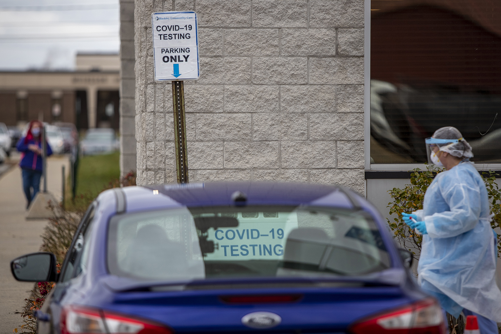 In this November 13 file photo, a nurse works at the Hackley Community Care Covid-19 curbside testing site in Muskegon Heights, Michigan.