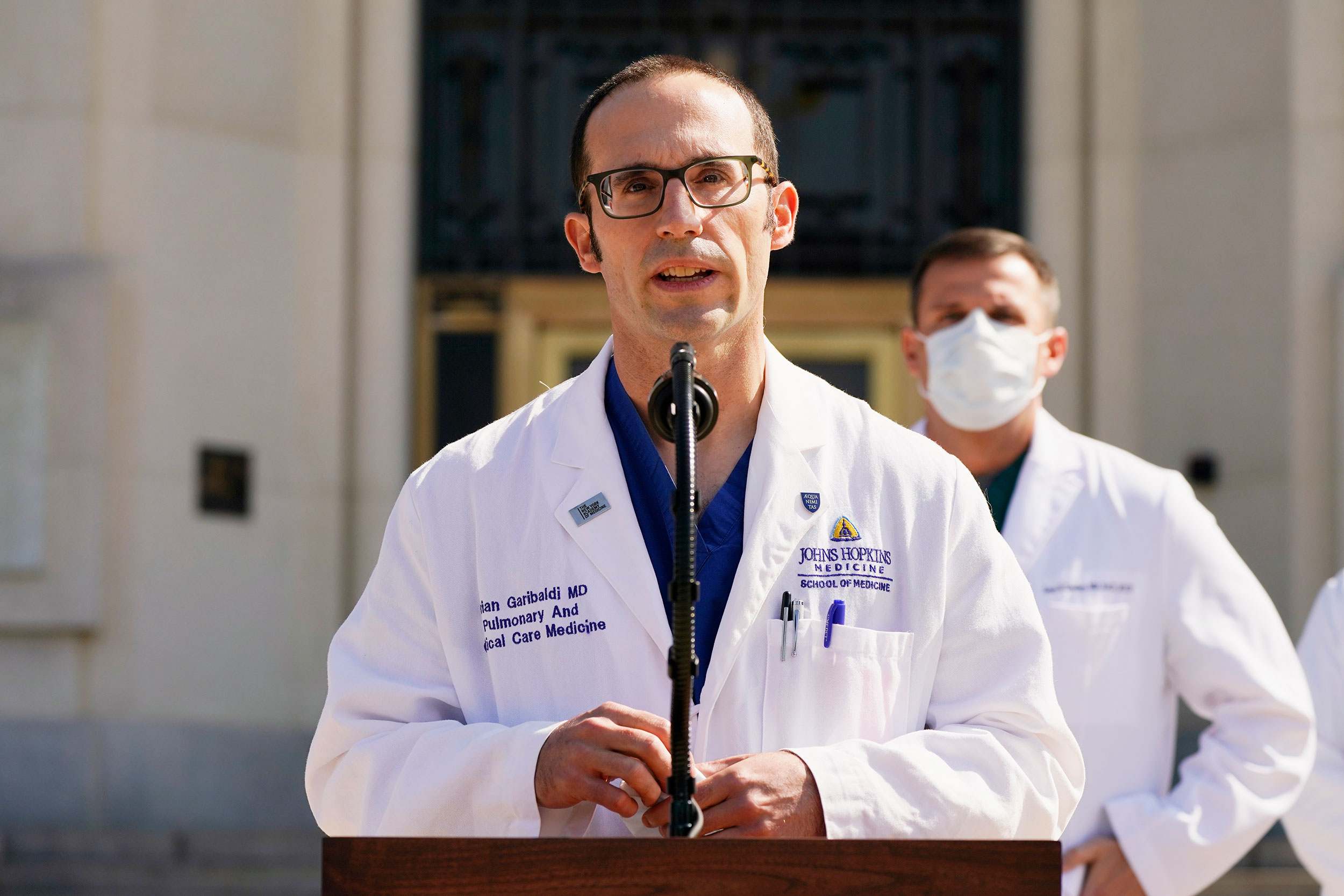 Dr. Brian Garibaldi speaks with reporters at Walter Reed National Military Medical Center on October 4 in Bethesda, Maryland.