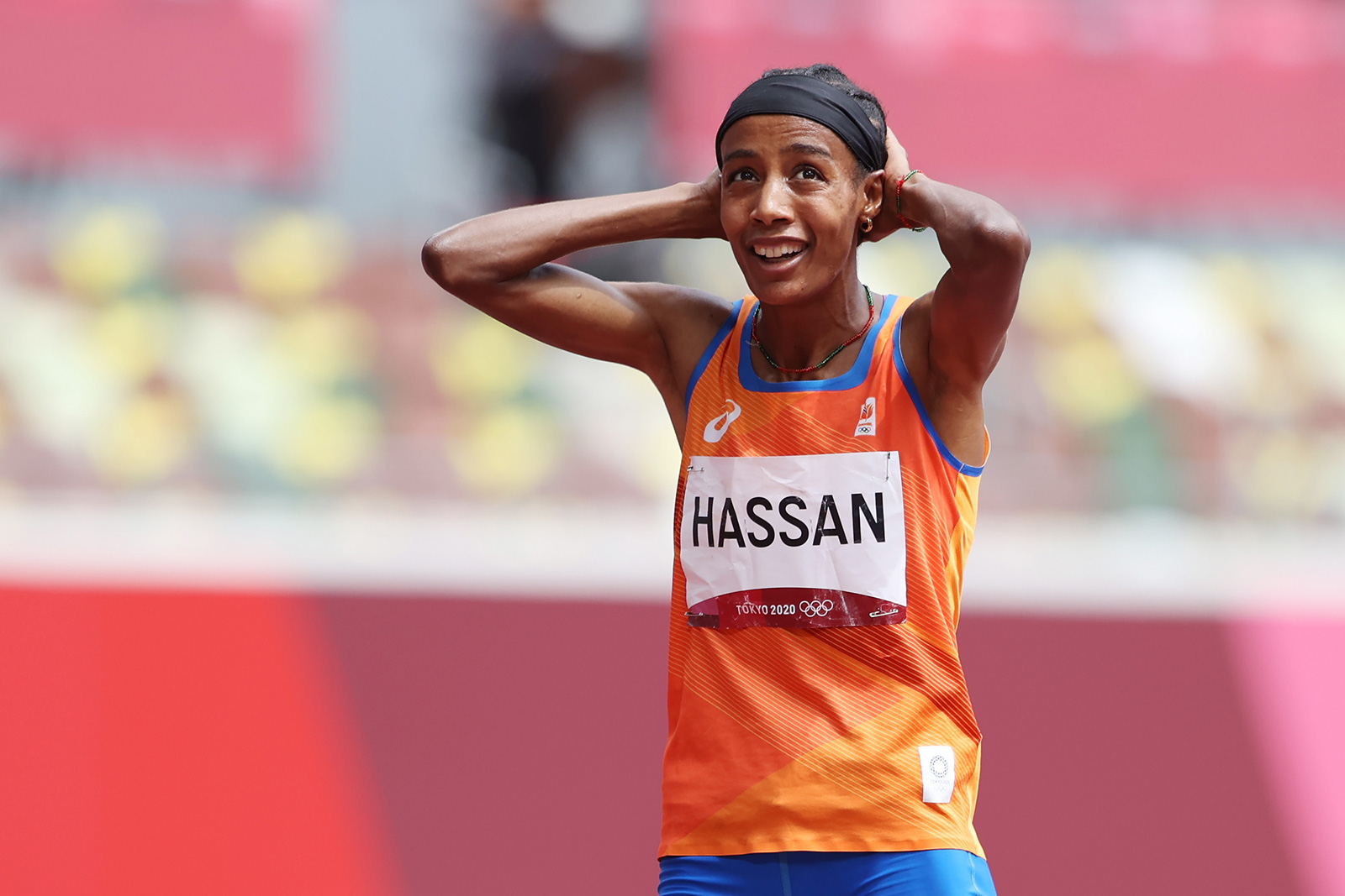 Sifan Hassan smiles after finishing a 1500 meter heat on Monday.